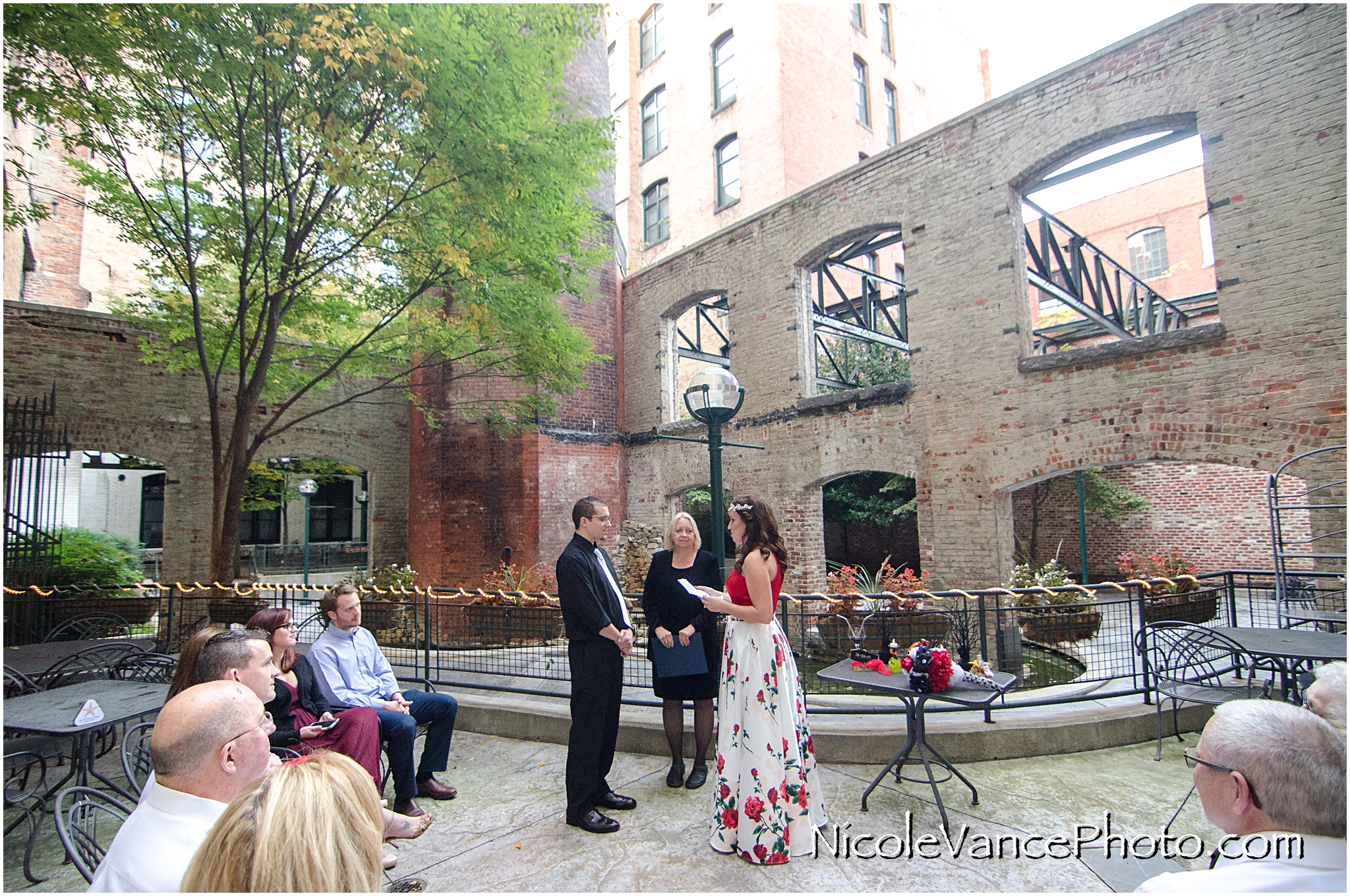 Wedding ceremony at Bookbinders on the back patio.