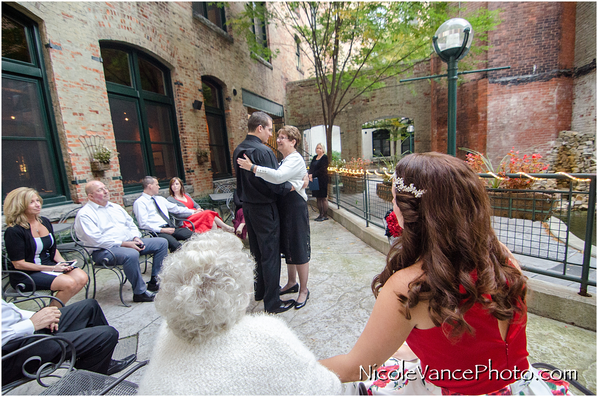 Mother son dance after a wedding ceremony at Bookbinders on the back patio.