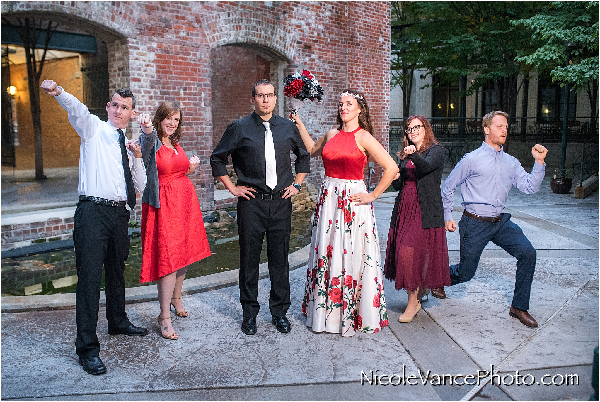 The friends pose as superheroes after a Micro-Wedding at Book Binders in Richmond VA.