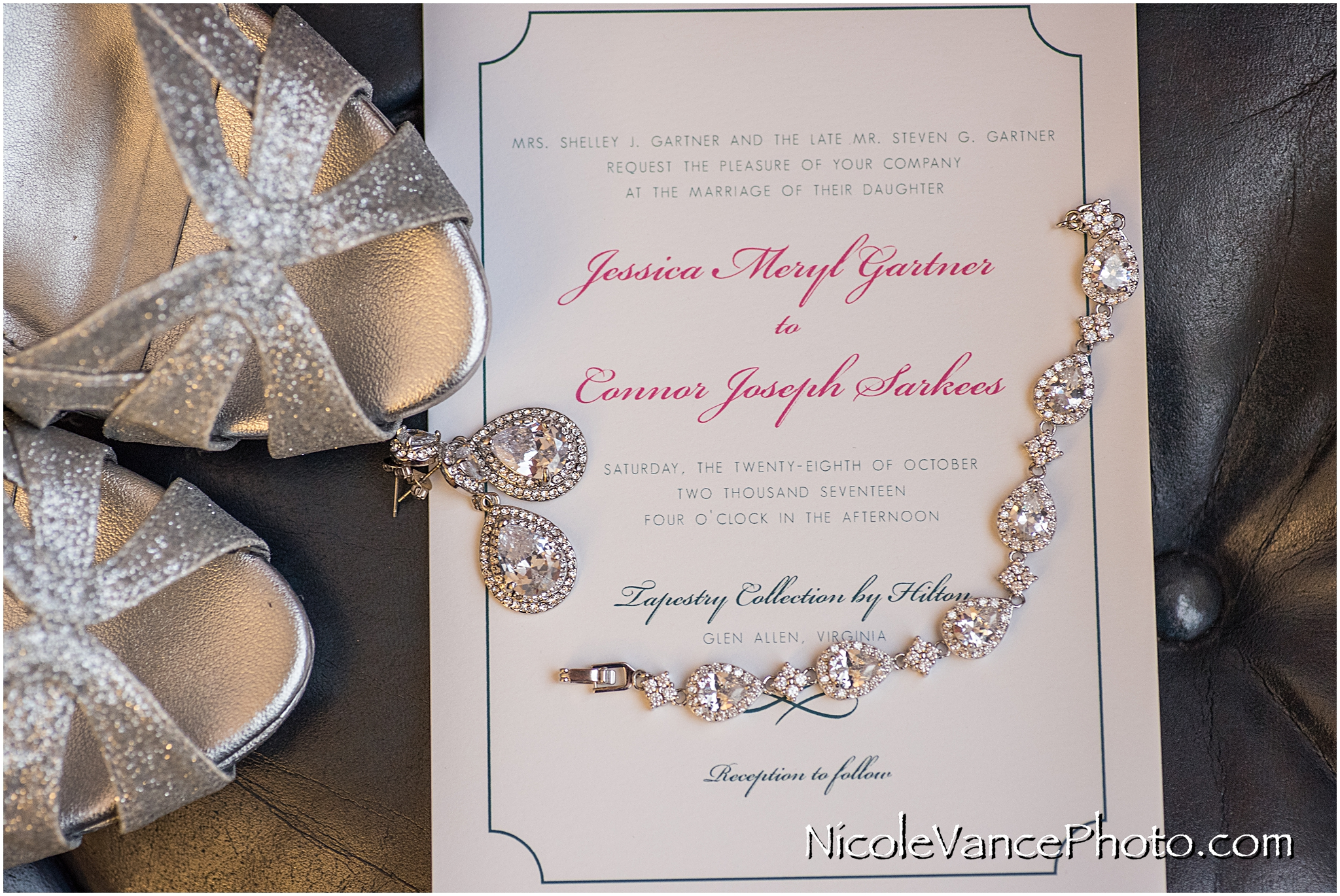 Wedding Invitation, by English Tea Paperie, based in Richmond VA, sits with other bridal details.