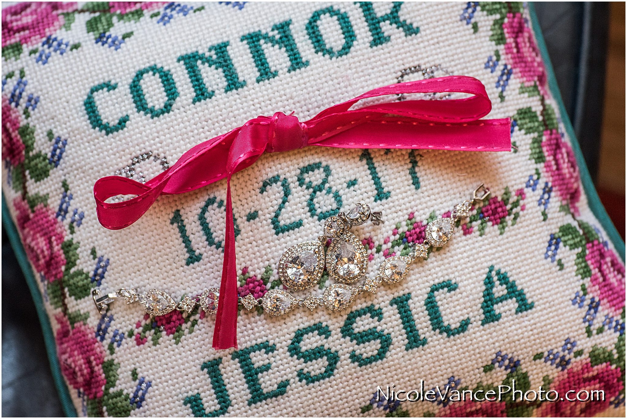 This handstiched needlepoint ring pillow is made bride's mom.