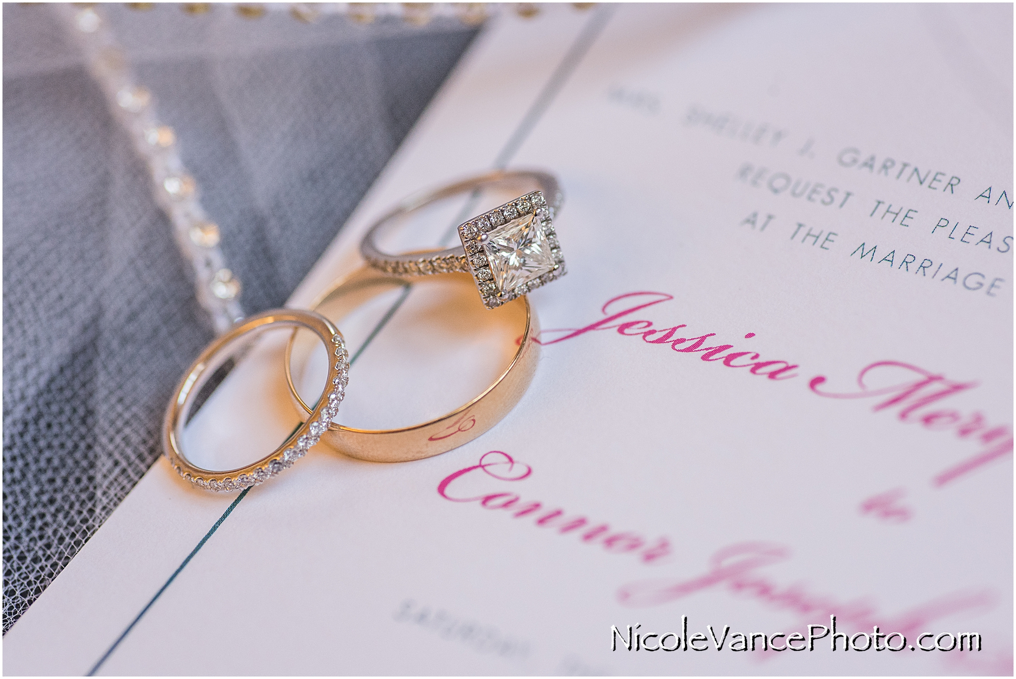 Wedding rings displayed with wedding invitation, made by English Tea Paperie.