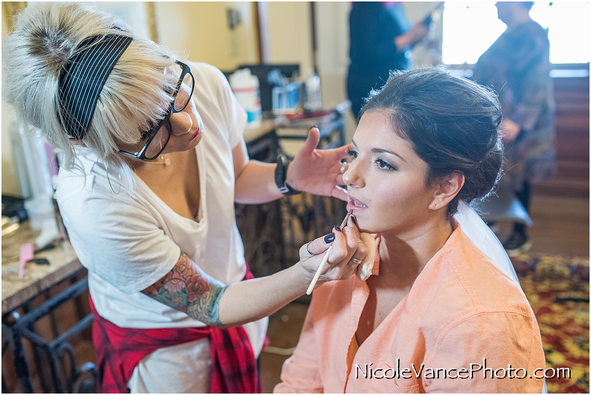 Finishing touches are being applied; hair and makeup was done by Jennifer Saunders Bridal.
