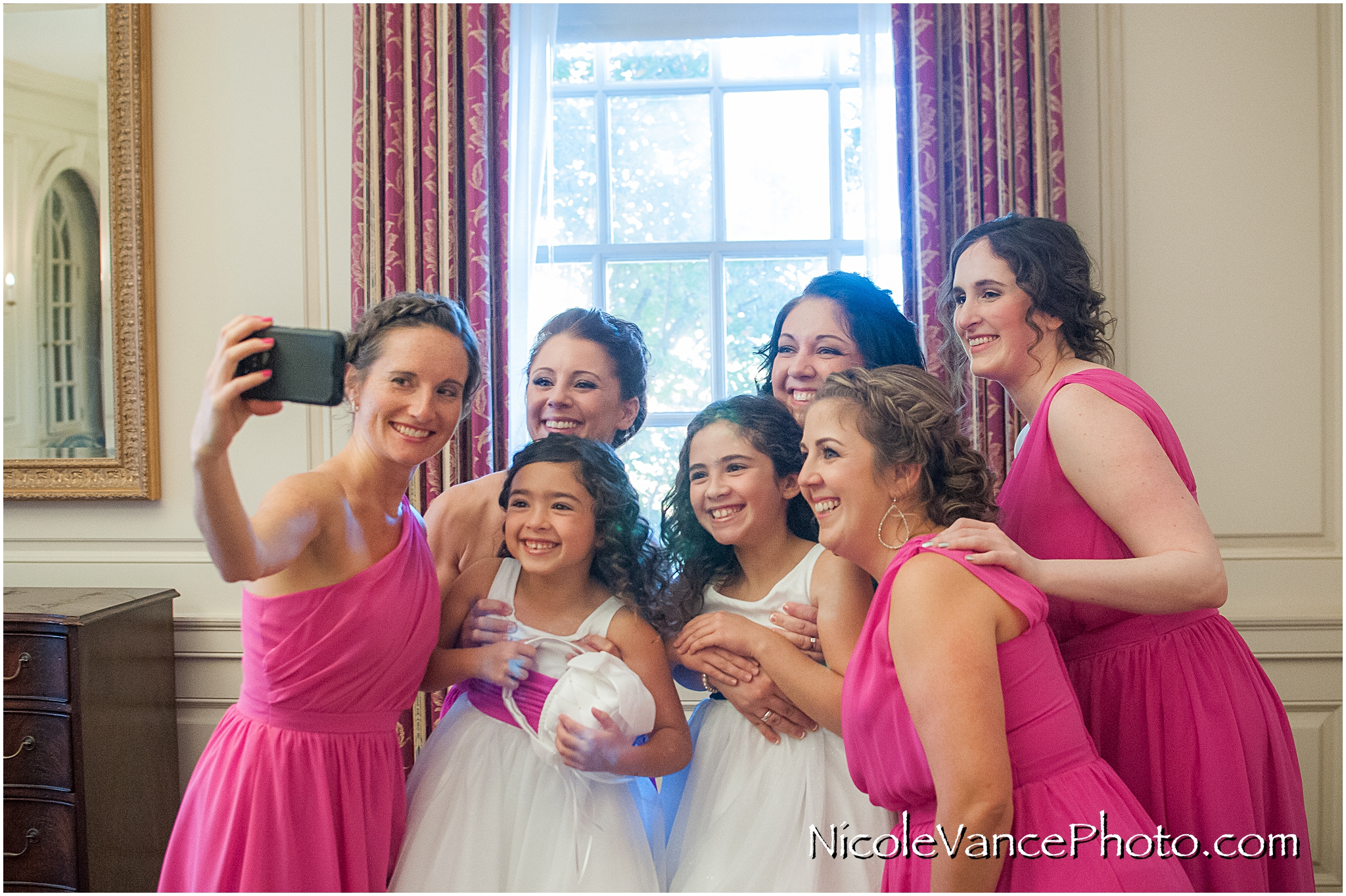 Members of the bridal party get together for a selfie in the conference room at Virginia Crossings.