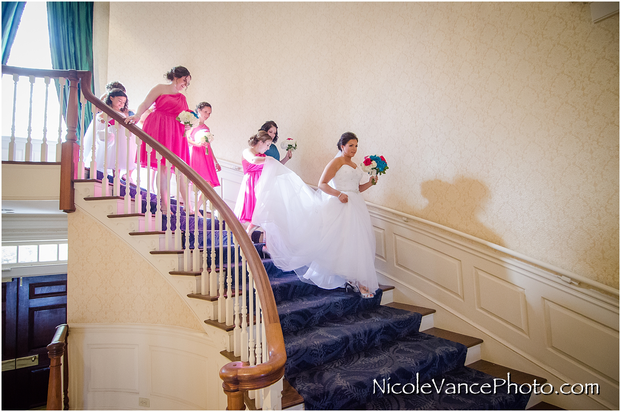 The bridal party makes their way down the stairs at Virginia Crossings.