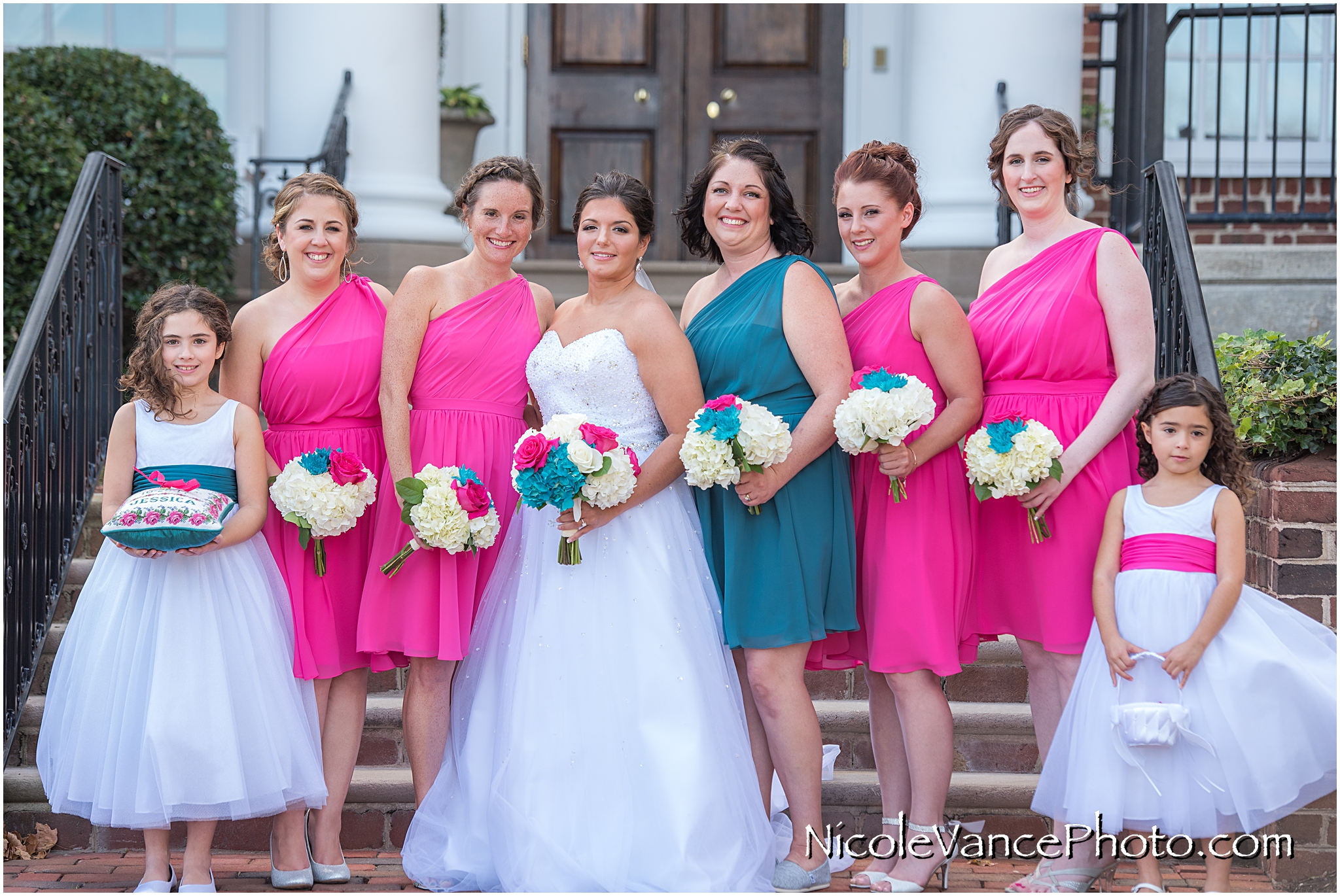 Bridal party portrait on the steps at Virginia Crossings.