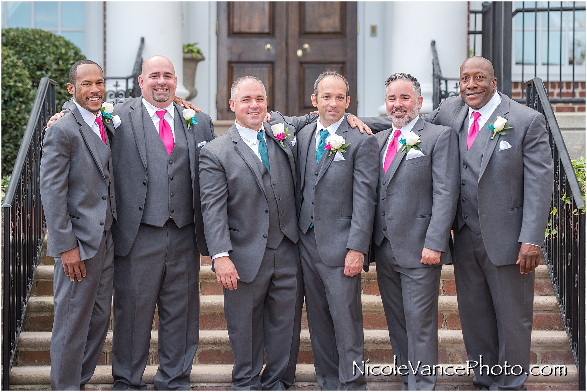 Groomsmen portrait on the steps at Virginia Crossings.