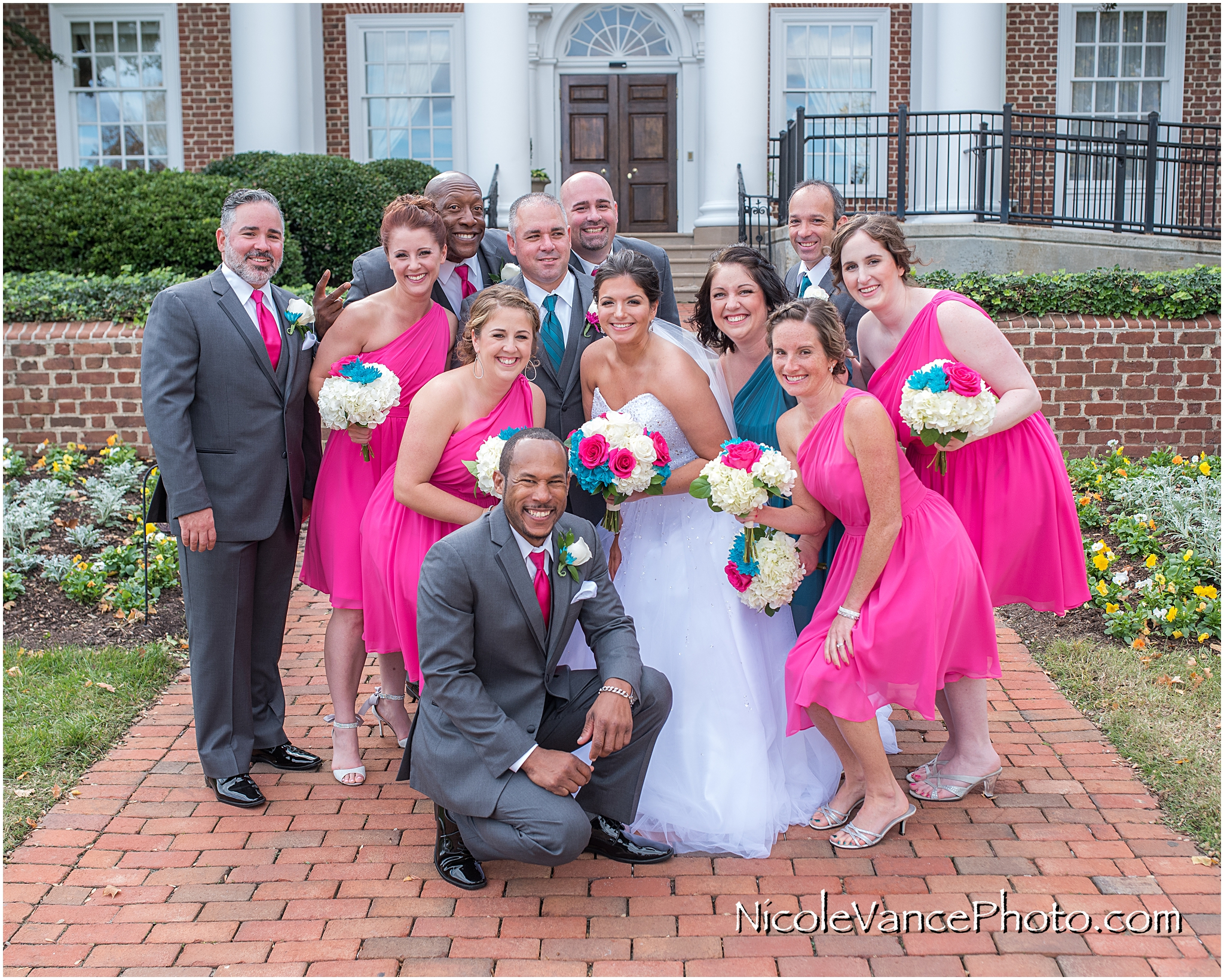 Wedding party portrait on the steps at Virginia Crossings.