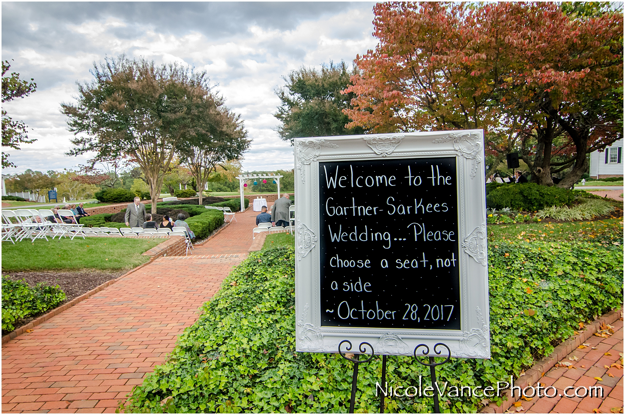 Wedding welcome sign sits at the entrance of the outdoor ceremony at Virginia Crossings.