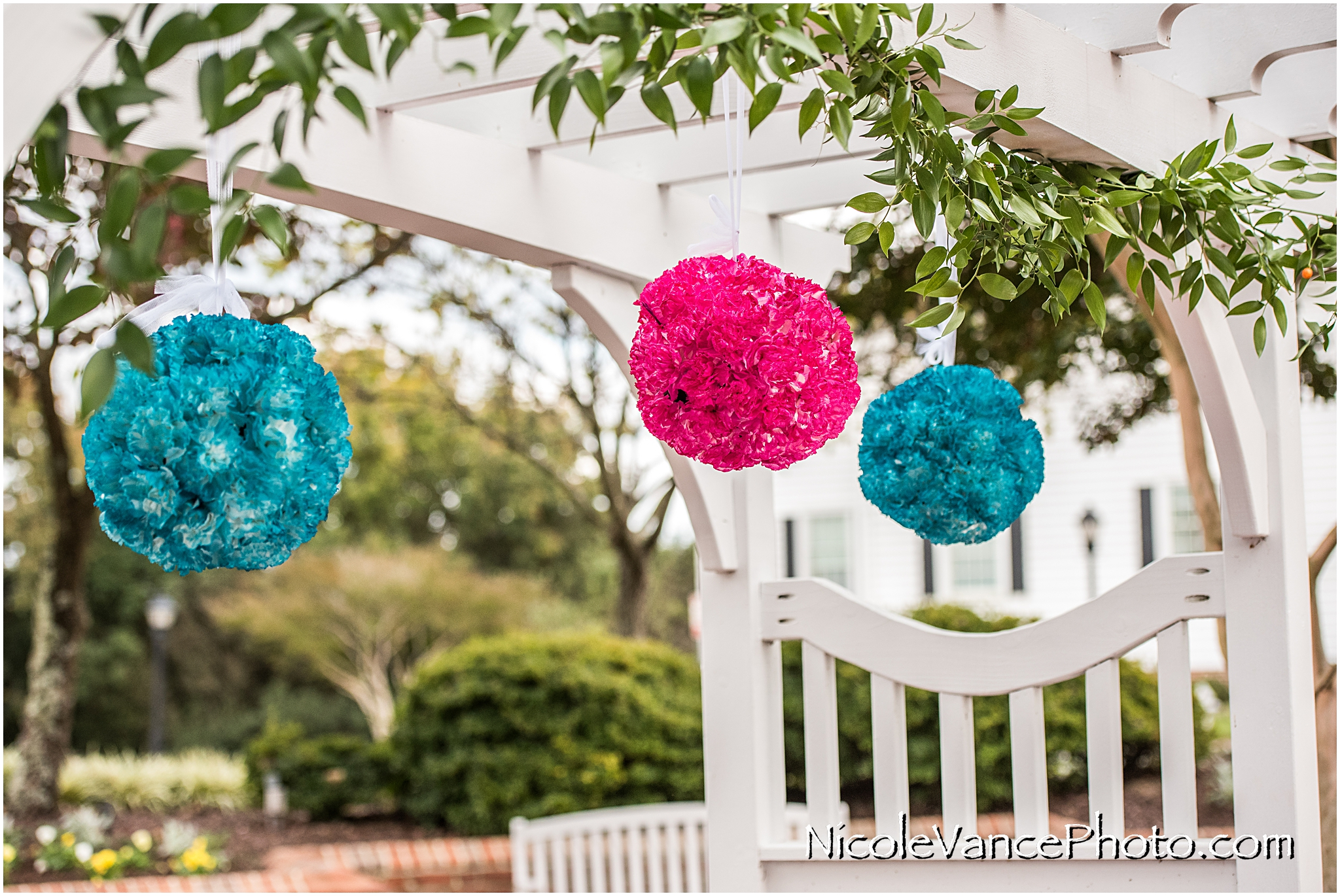 Floral Pomander Balls decorate the pergola at the ceremony site at Virginia Crossings.