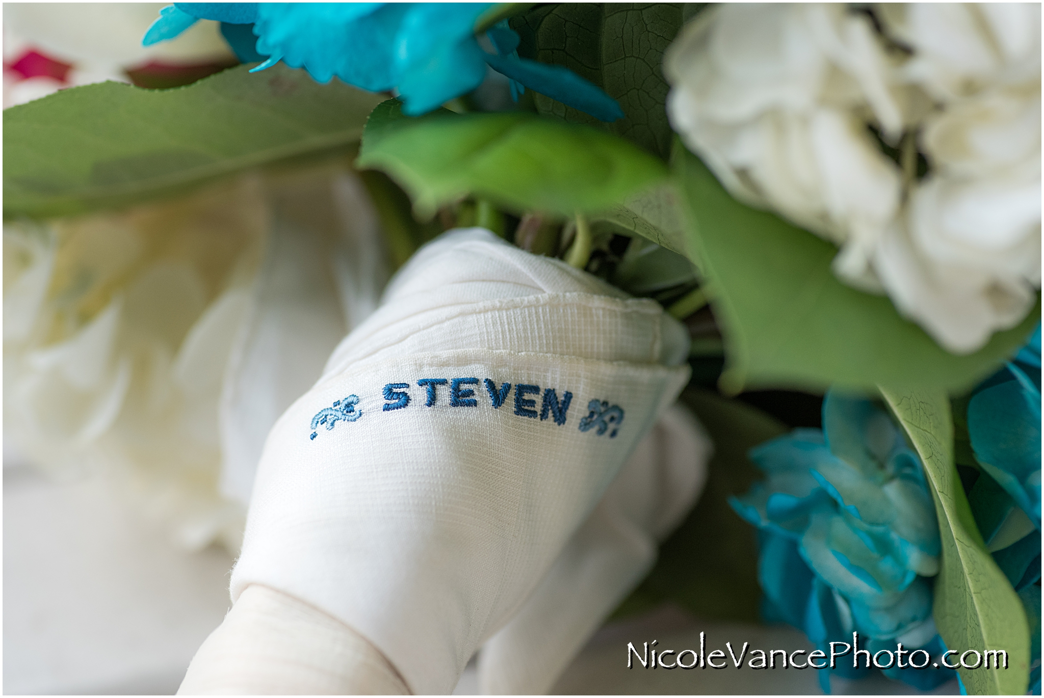 The bride's father's handkerchief decorates the base of her bouquet in his memory.