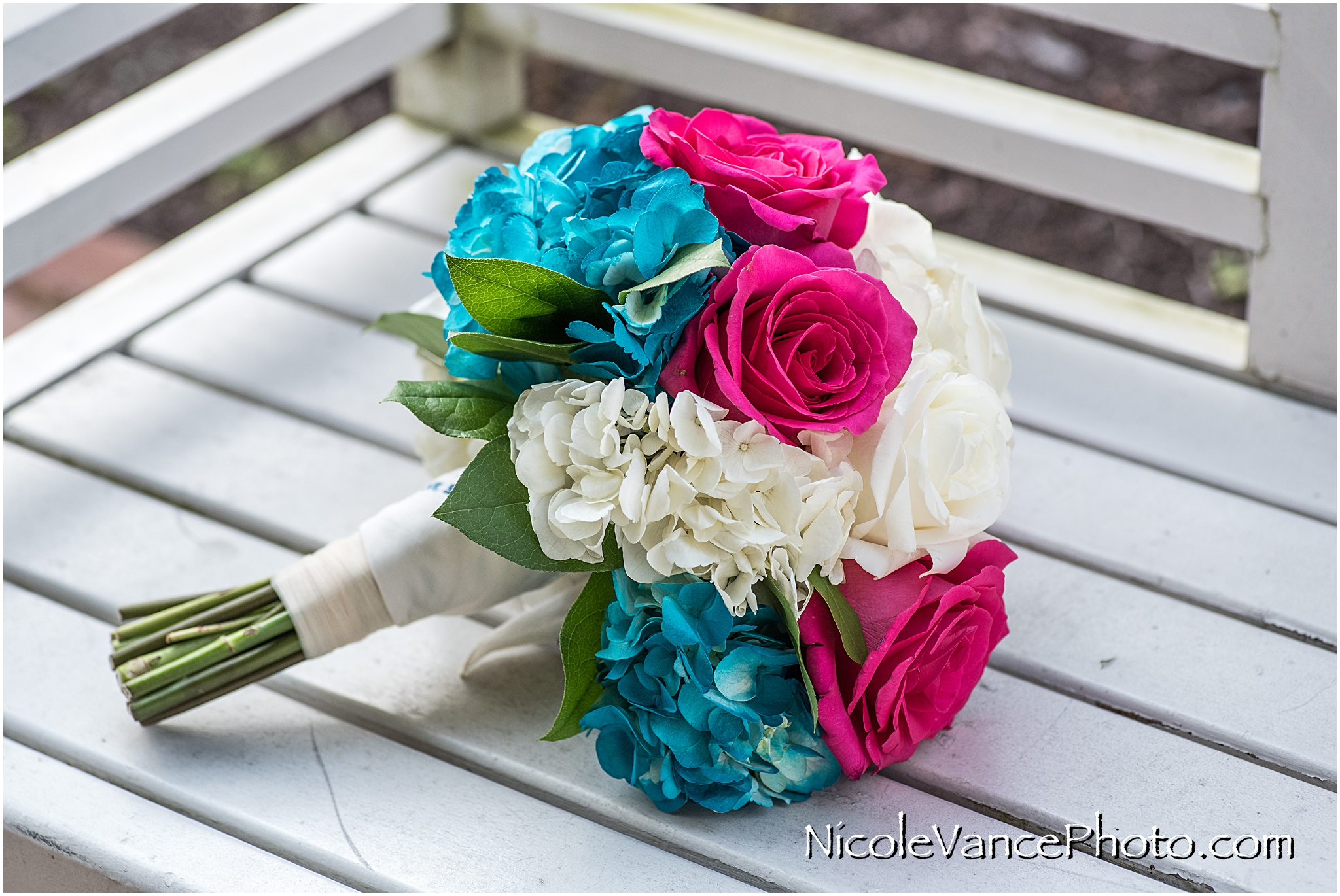 This bridal bouquet was designed by Flowers by Zoie.