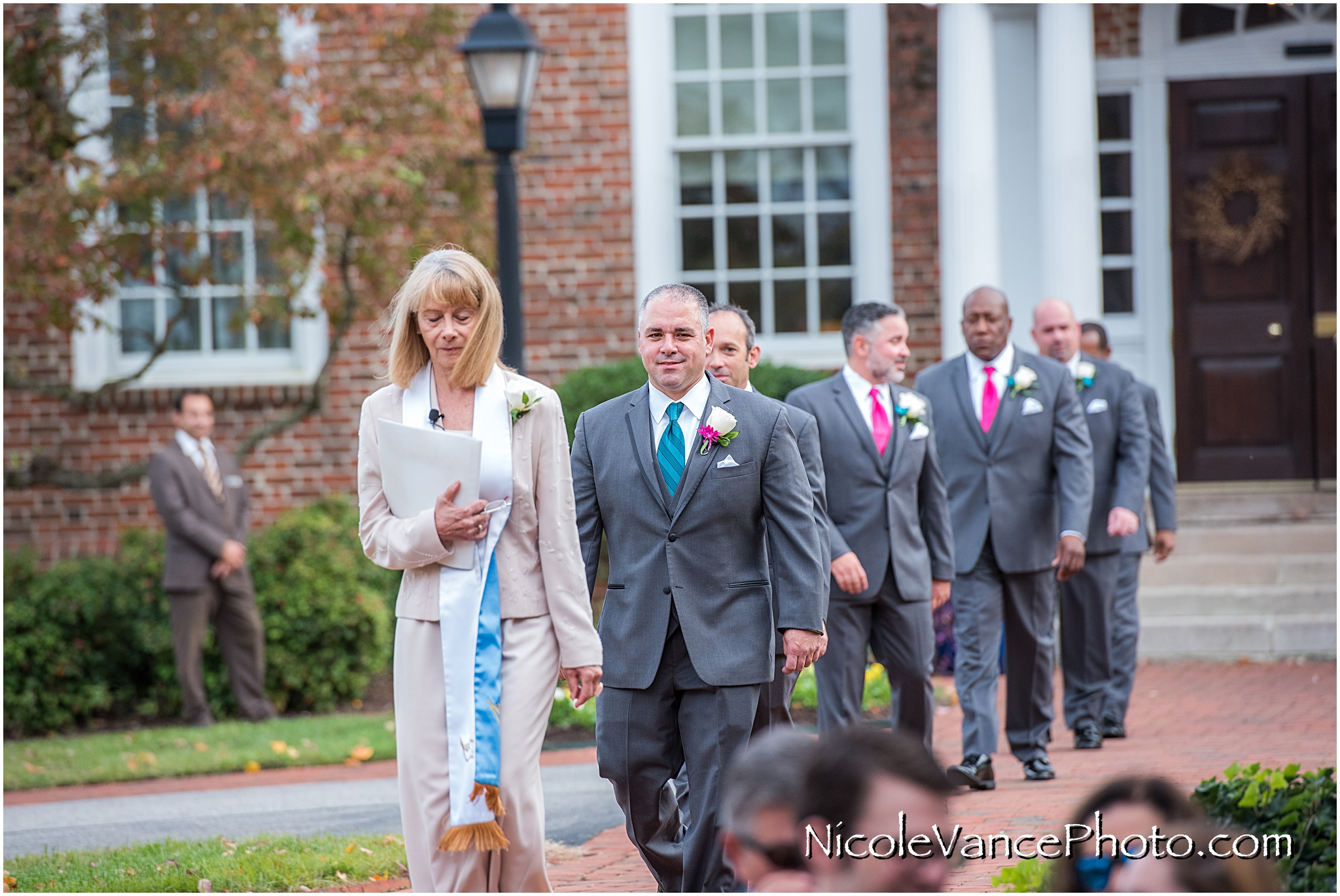 "The groom exits ""The Tavern"" to the ceremony site at Virginia Crossings."