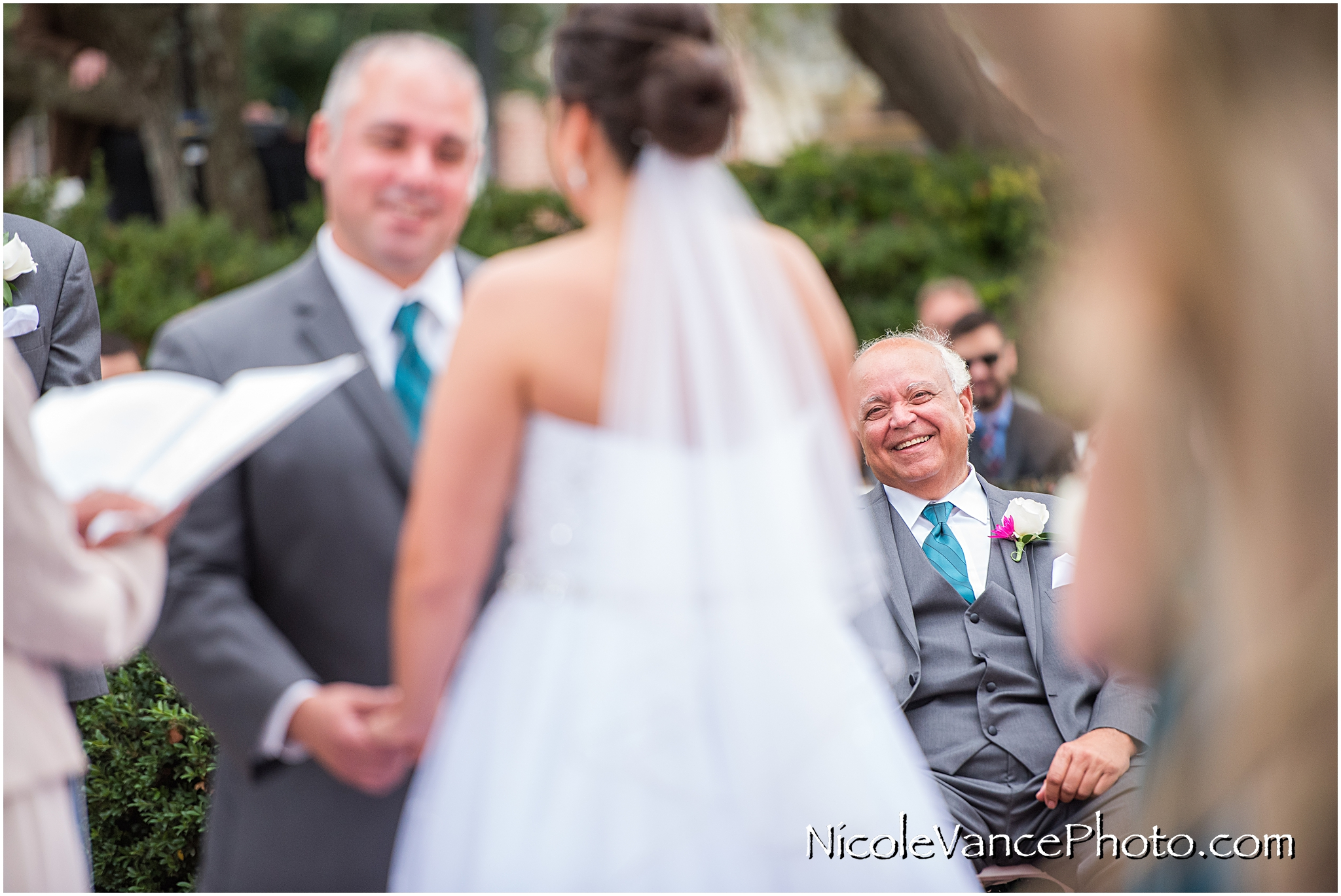 The groom's father during the wedding ceremony at Virginia Crossings.