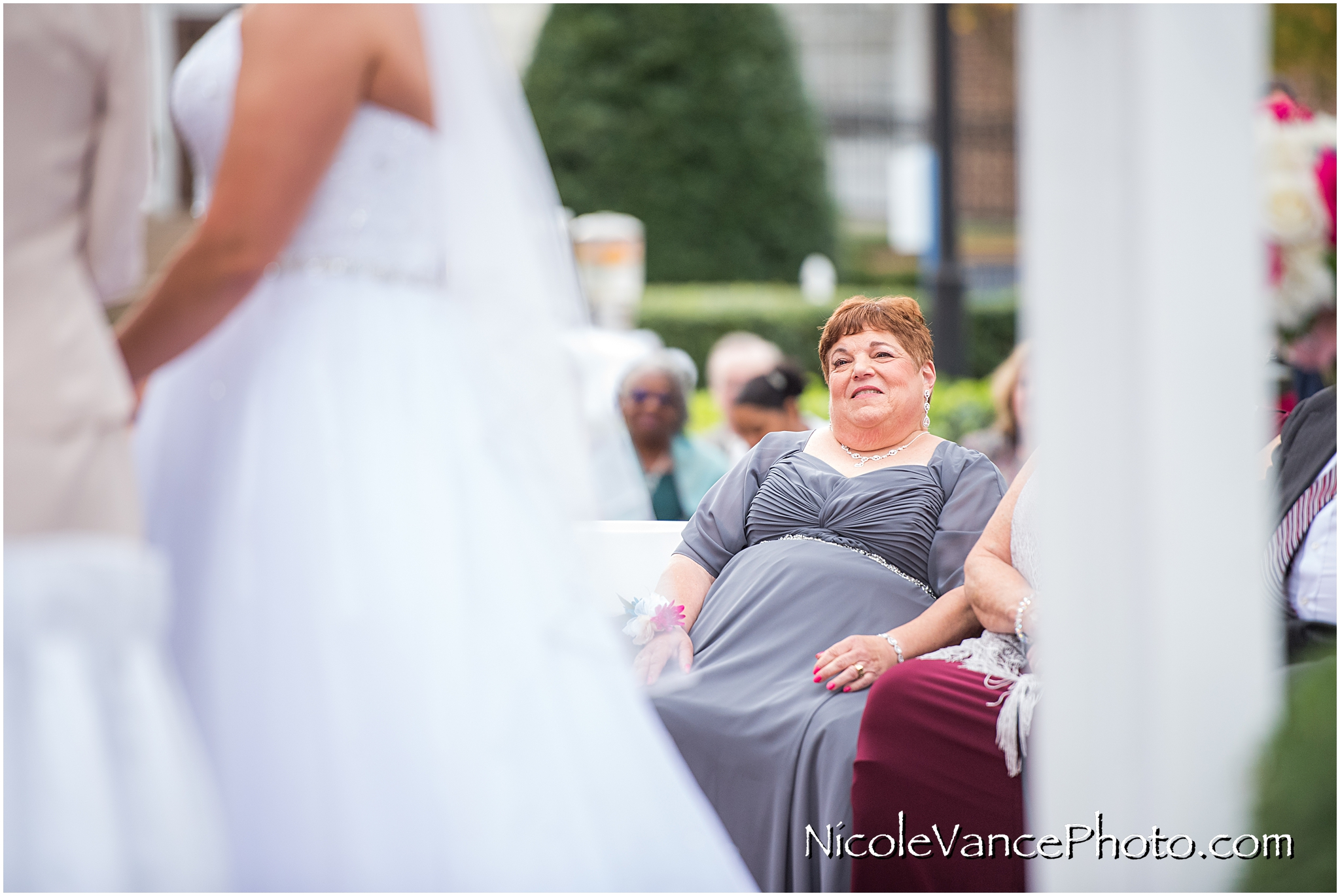 The bride's mother during the wedding ceremony at Virginia Crossings.