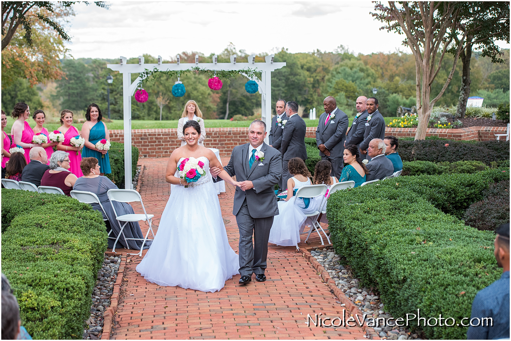 The bride and groom exit the ceremony at Virginia Crossings.