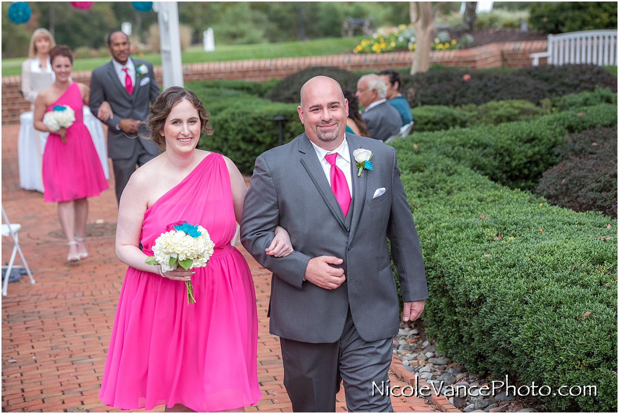 The wedding party exits the ceremony at Virginia Crossings.
