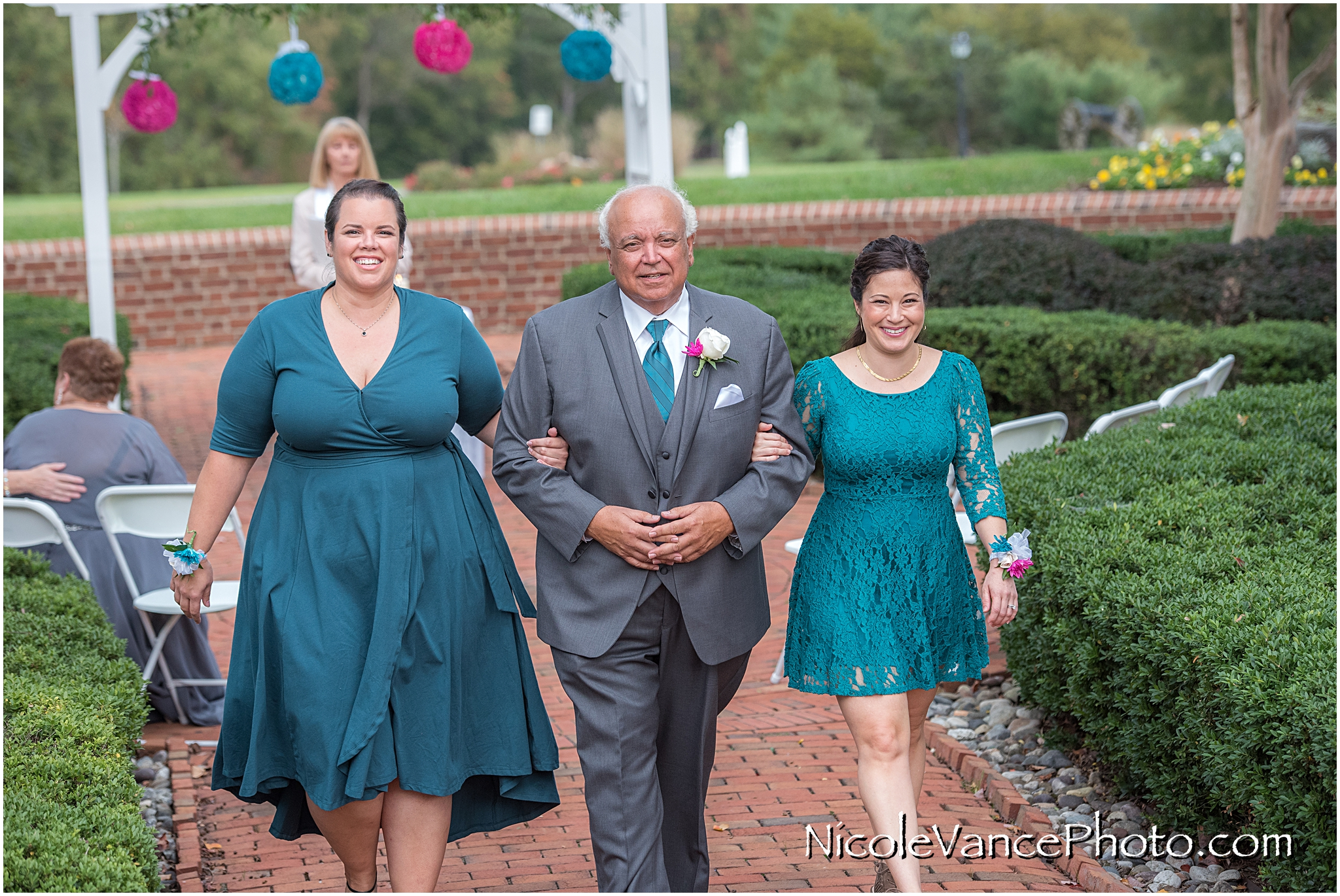 The family exits the ceremony at Virginia Crossings.