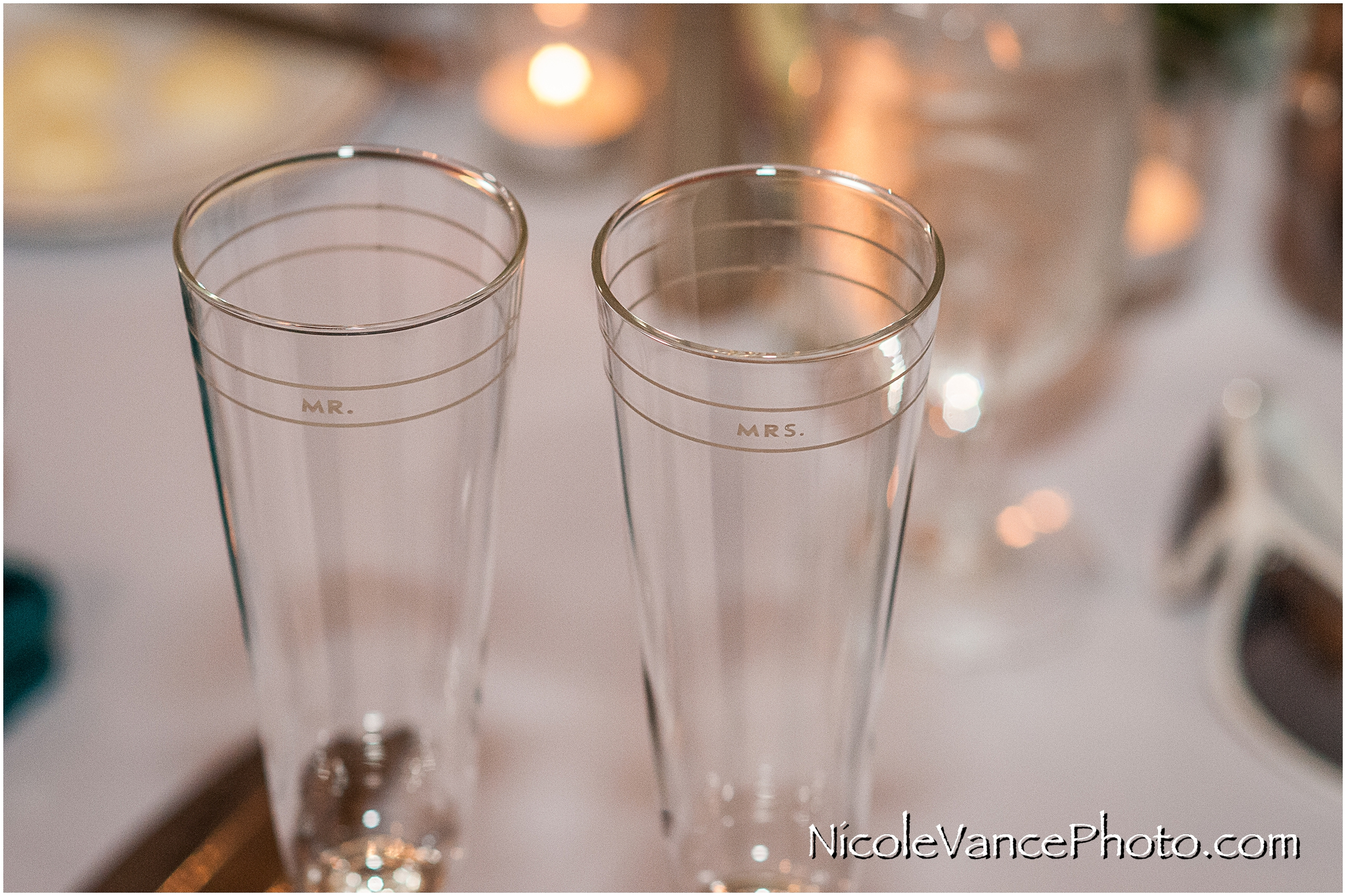 Mr & Mrs champagne glasses at the reception in the ballroom at Virginia Crossings.