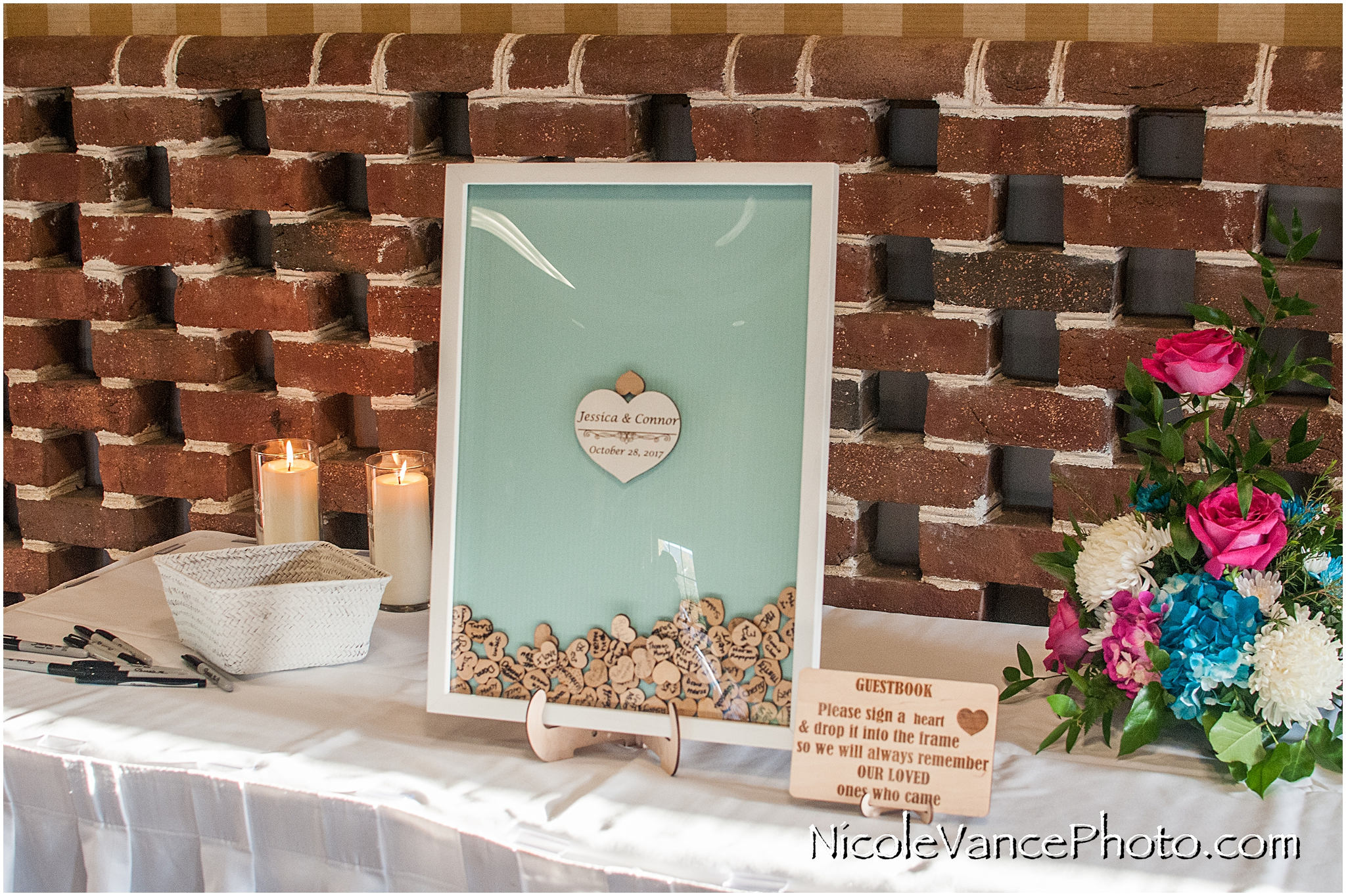 Sign a heart personalized wedding guestbook.