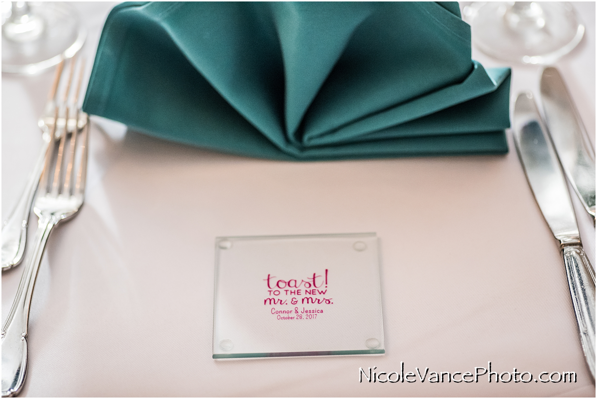 Wedding favors are personalized glass coasters.