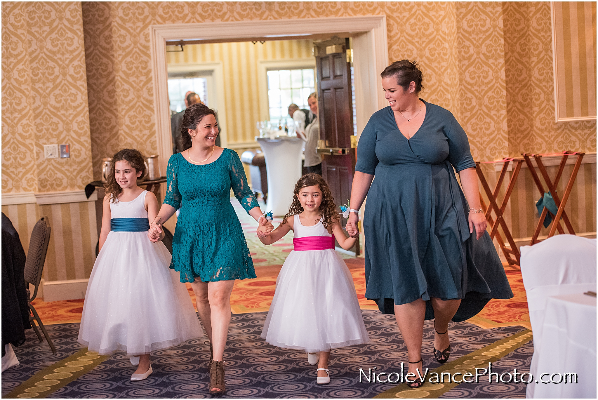 Family and Bridal party enter the Wedding Reception at Virginia Crossings.