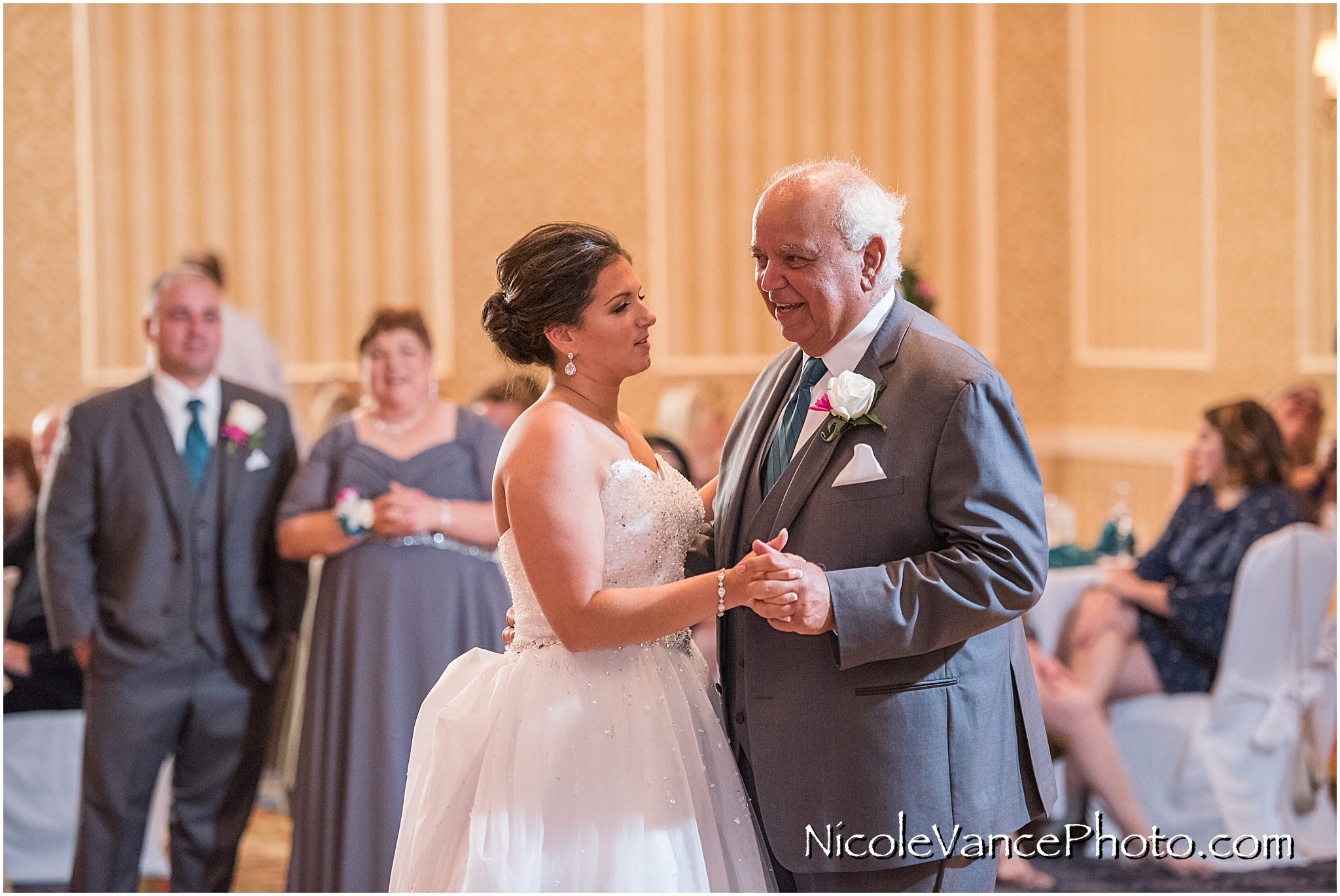 The bride dances with her new father in law in the ballroom at Virginia Crossings.
