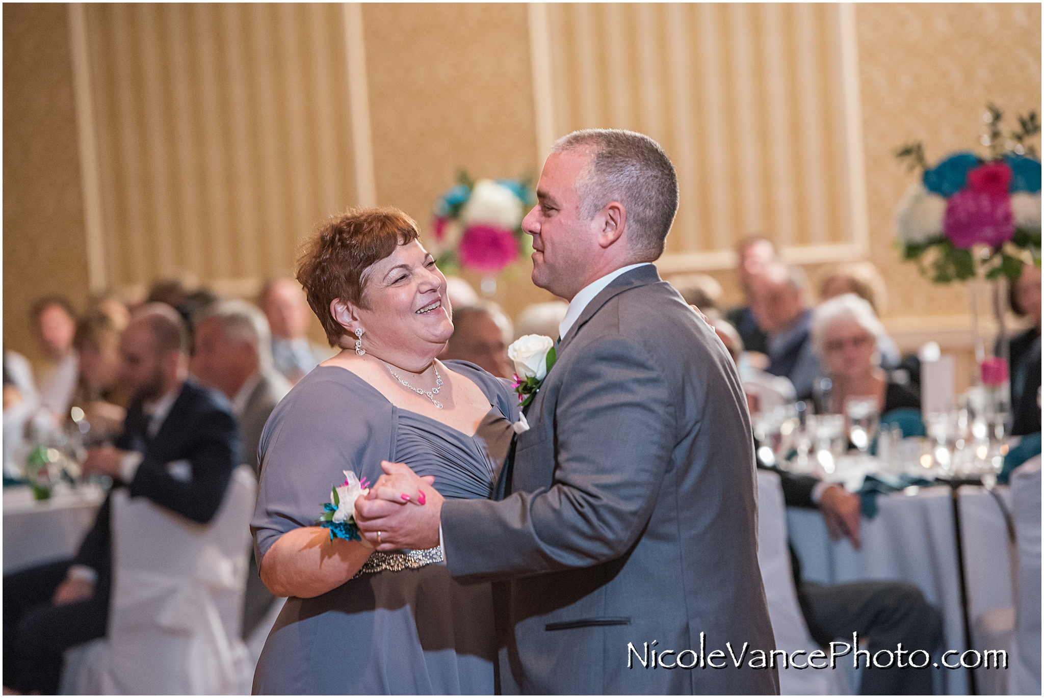 The groom dances with his new mother in law in the ballroom at Virginia Crossings.