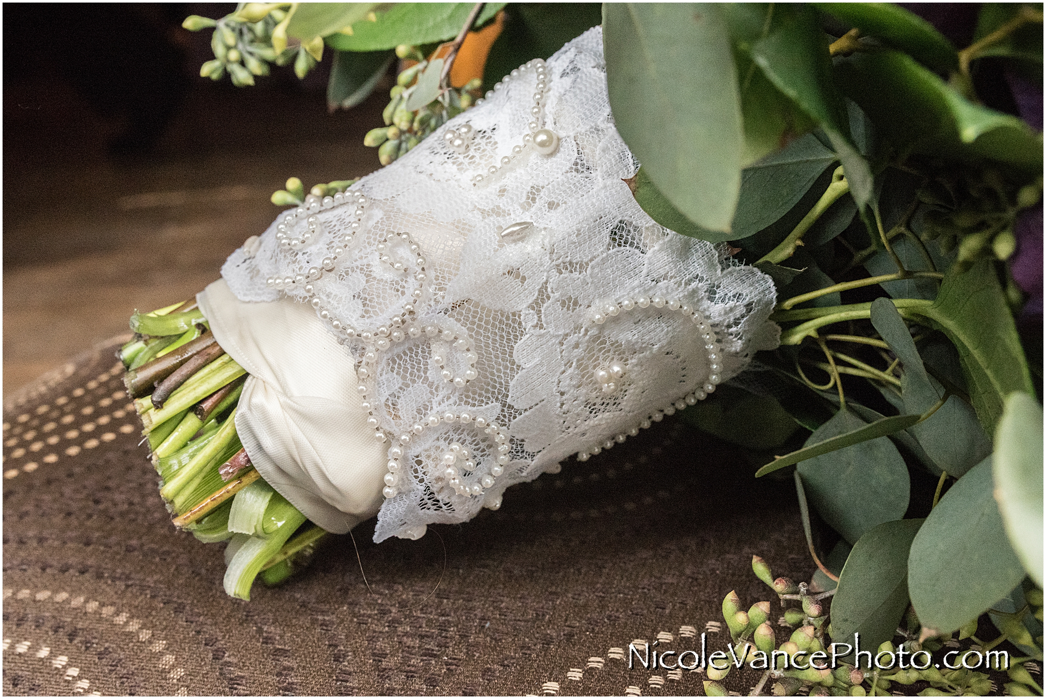 The vintage lace on the bride's bouquet is from her mother's wedding gown.