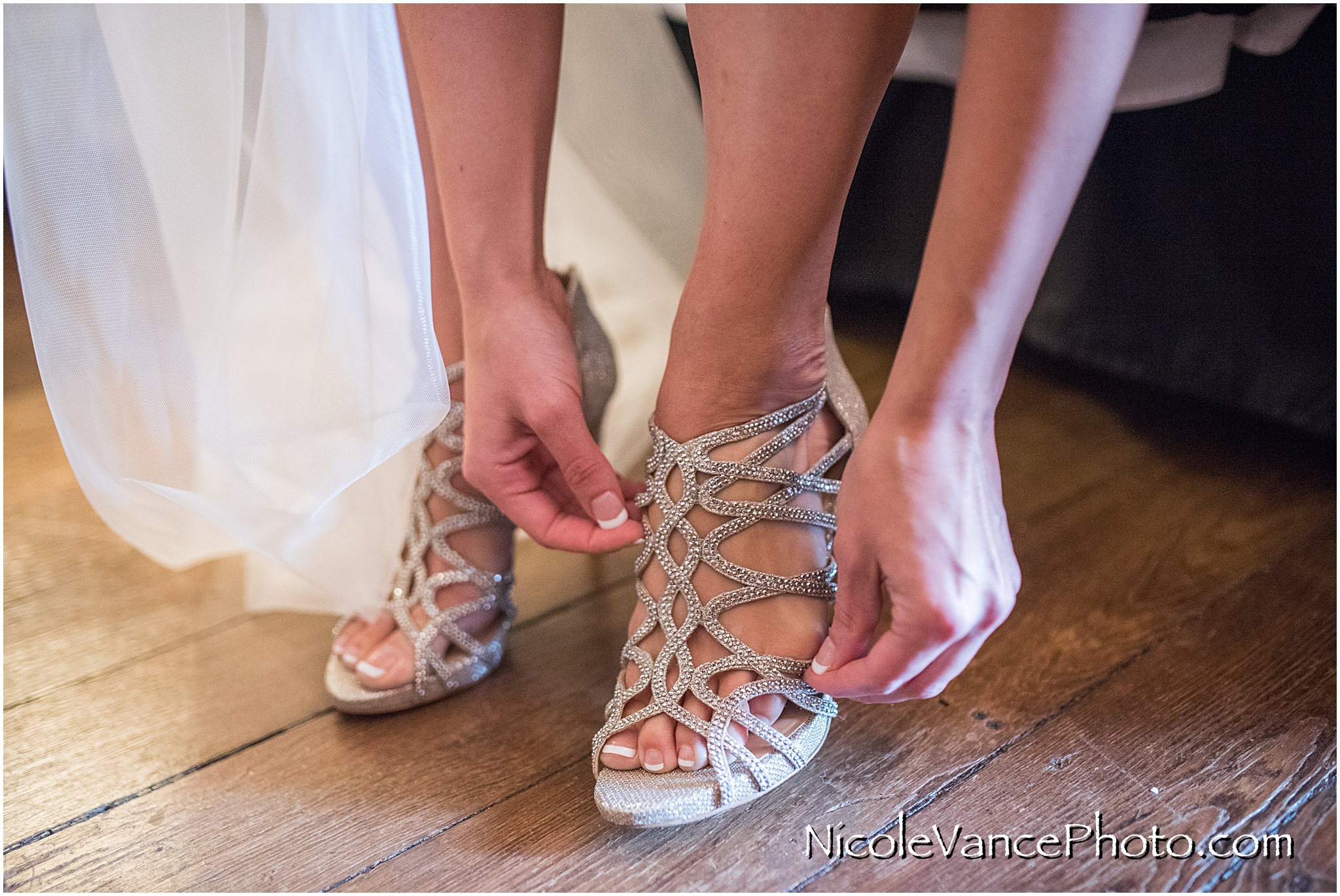 The bride put on her shoes.