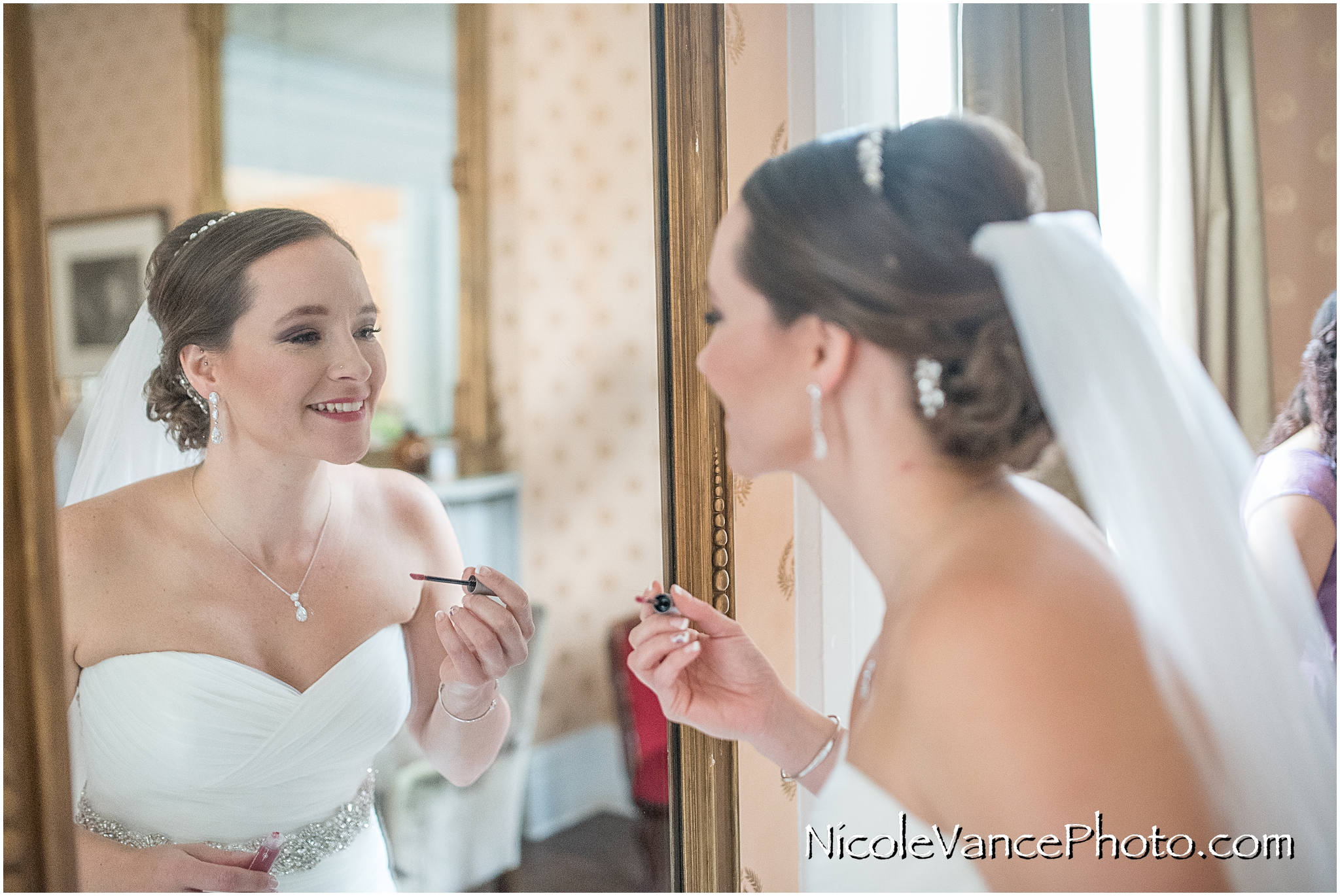 Last minute lipstick touch up before her first look with her husband-to-be.