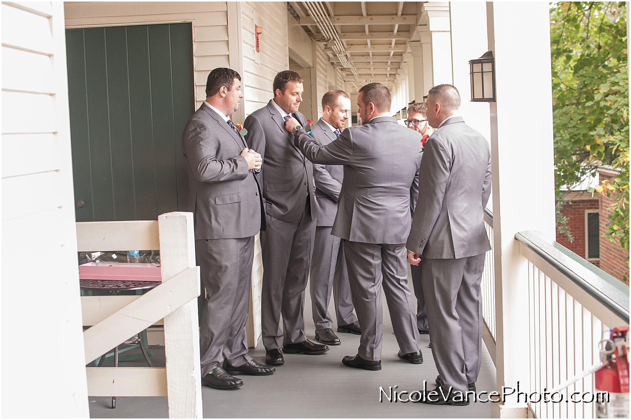 The groom enjoys a few minutes together with his groomsmen at the Linden Row Inn, in Richmond, VA.