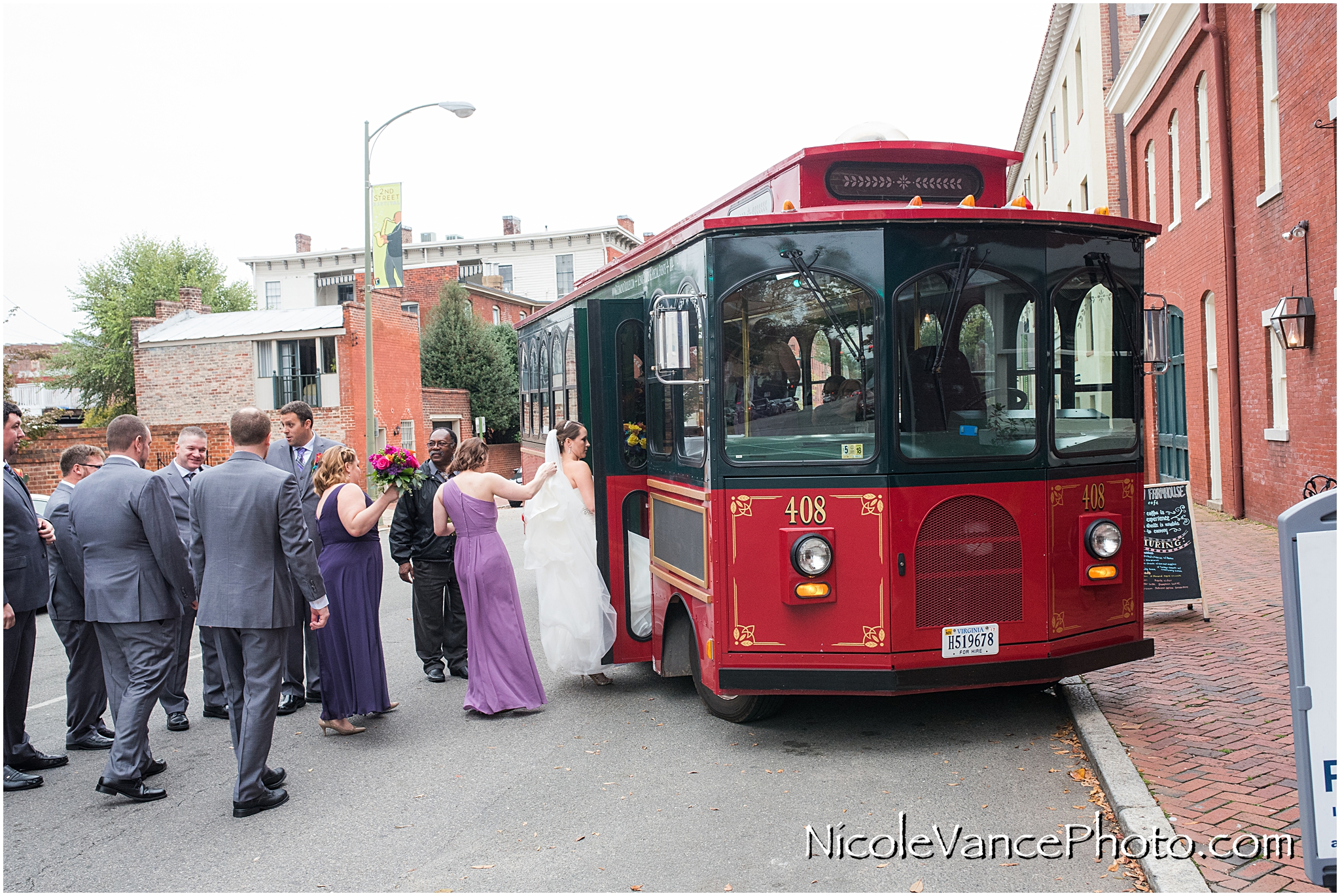 The bridal party boards the trolley to travel to the wedding ceremony at the Church.