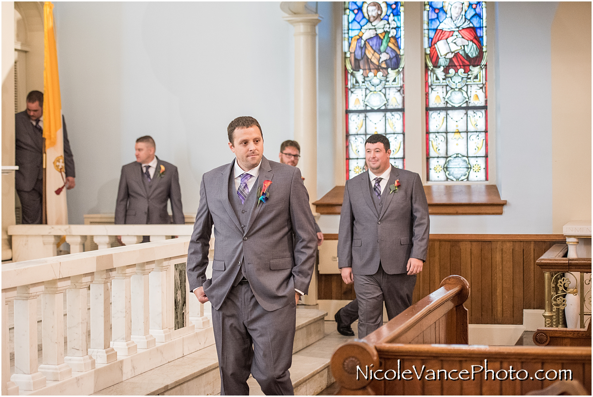 The groom makes an entrance at St Peter's Catholic Church, in Richmond VA.