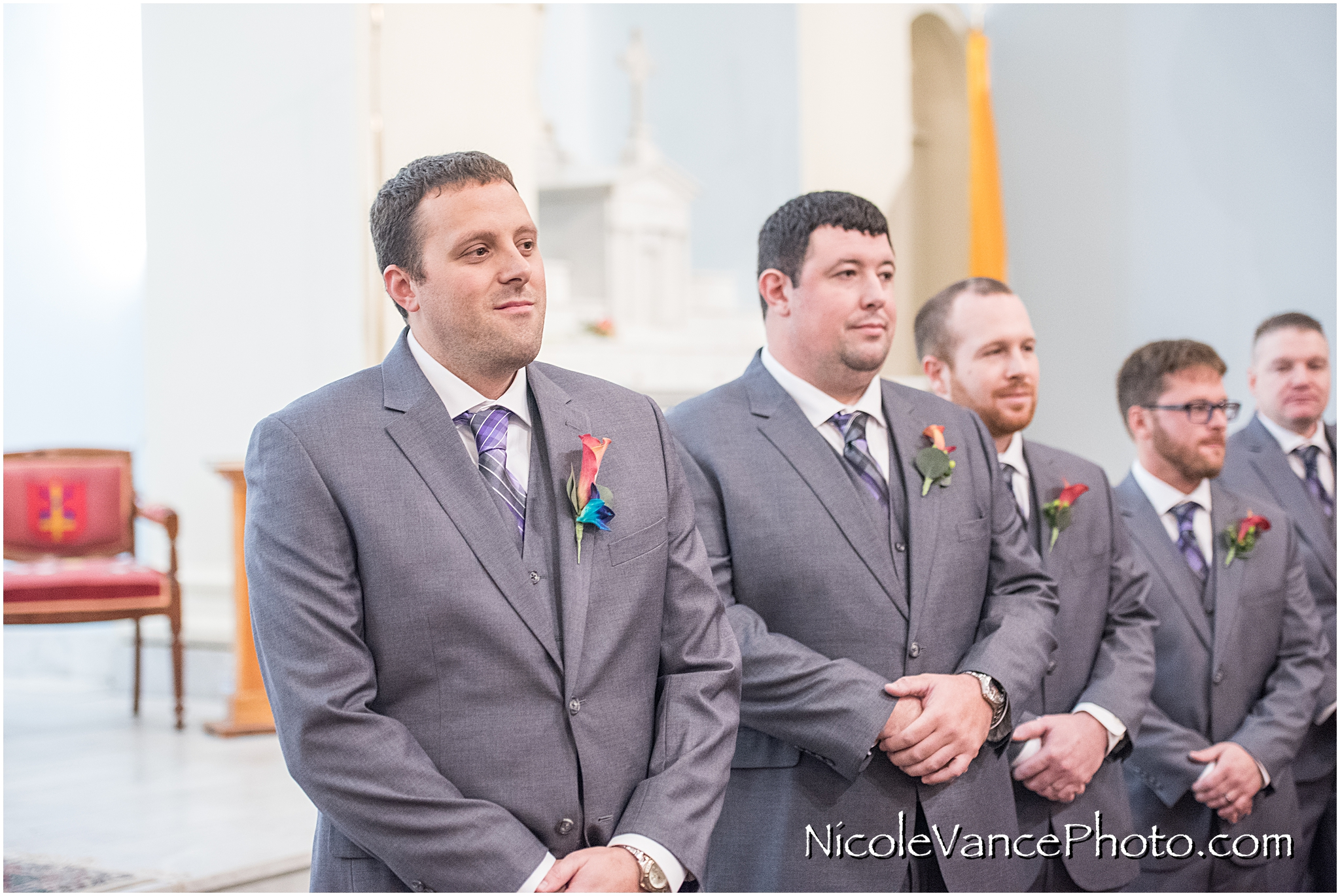 The groom sees his bride enter at St Peter's Catholic Church, in Richmond VA.