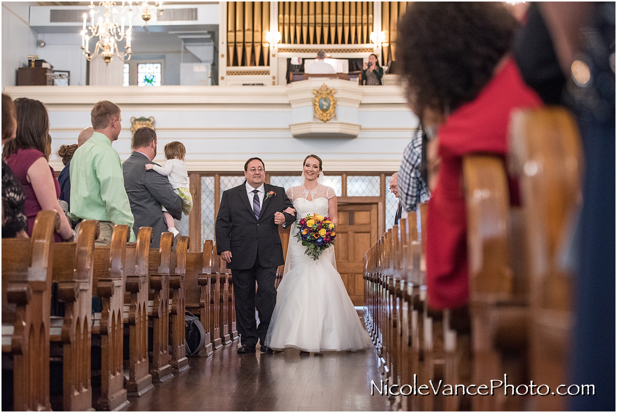 The bride makes an entrance at St Peter's Catholic Church, in Richmond VA.