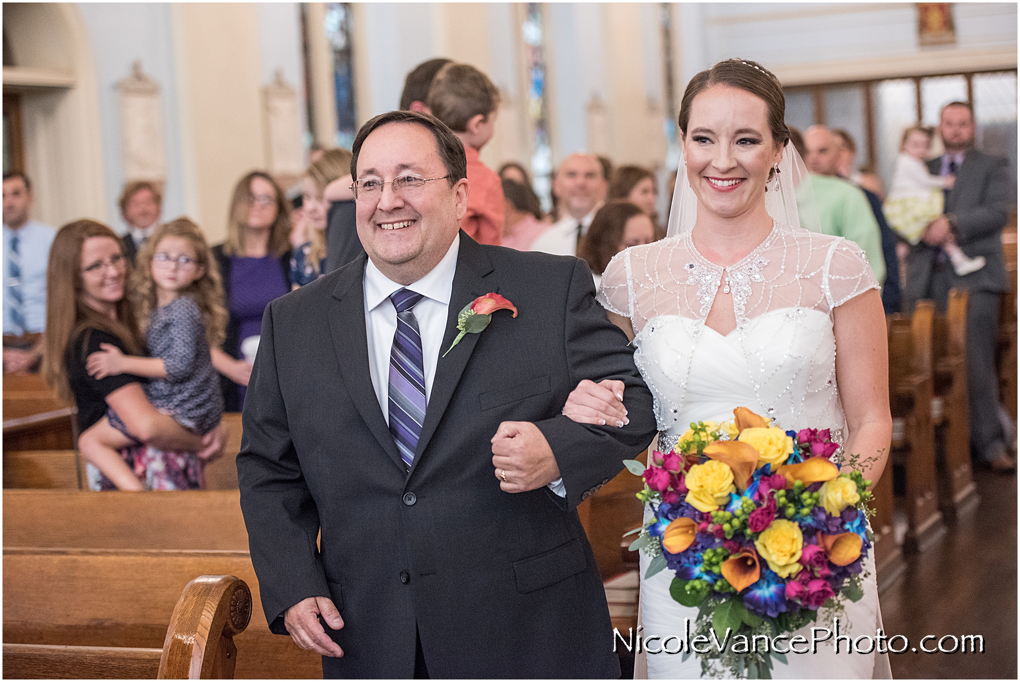 The bride makes an entrance at St Peter's Catholic Church, in Richmond Virginia.
