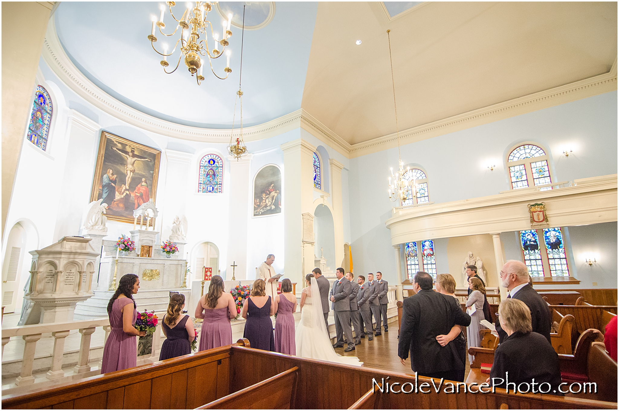 The wedding ceremony takes place at the beautiful and historic St Peter's Catholic Church in Richmond, Virginia.