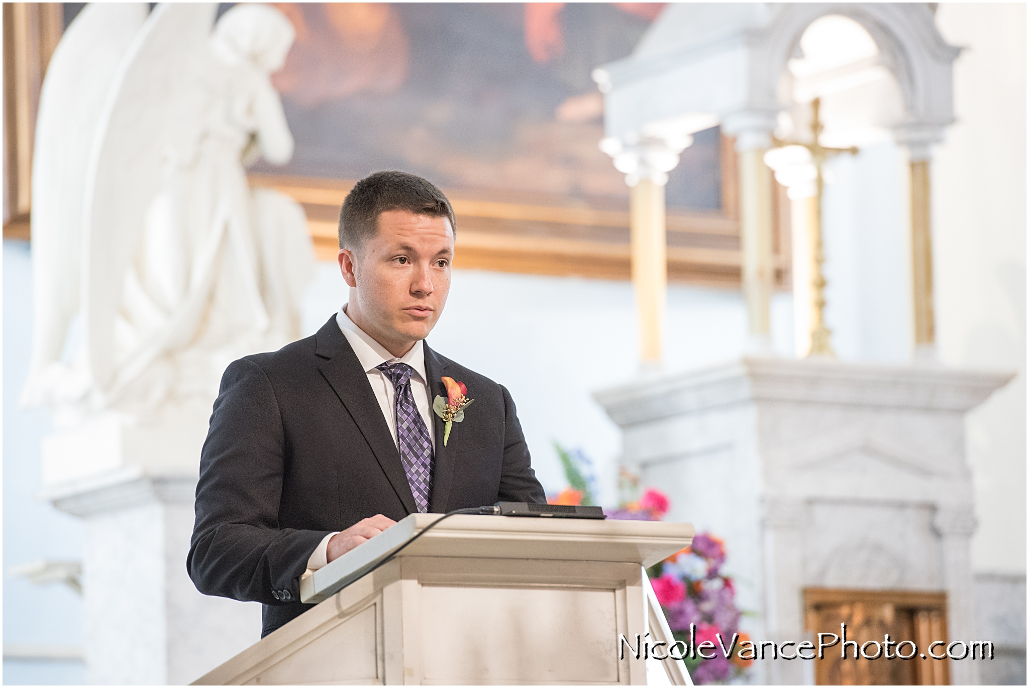 Scripture is read during a wedding ceremony at St Peter's Catholic Church in Richmond, Virginia.