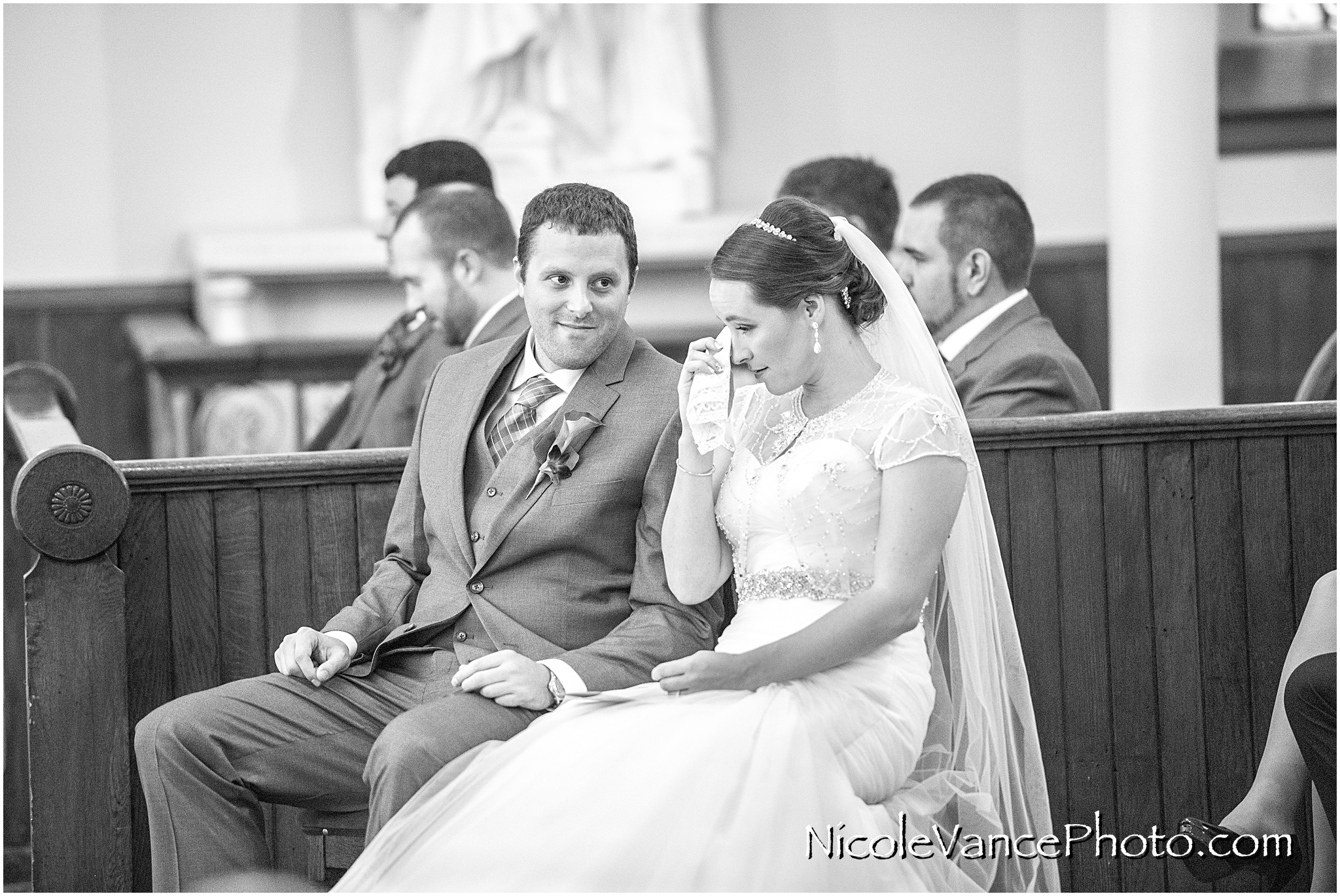 The bride and groom enjoy their wedding ceremony at St Peter's Catholic Church in Richmond, VA.