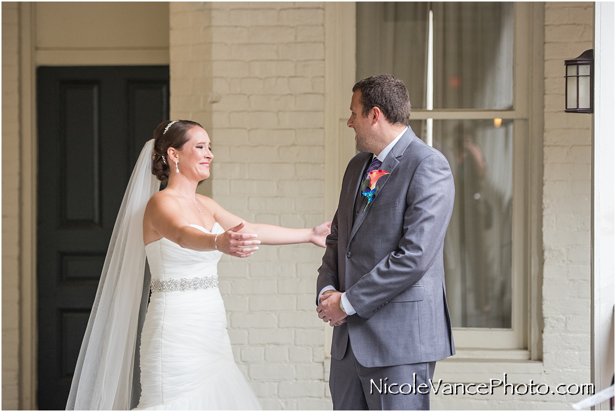 An emotional and touching first look together on the balcony at Linden Row Inn.