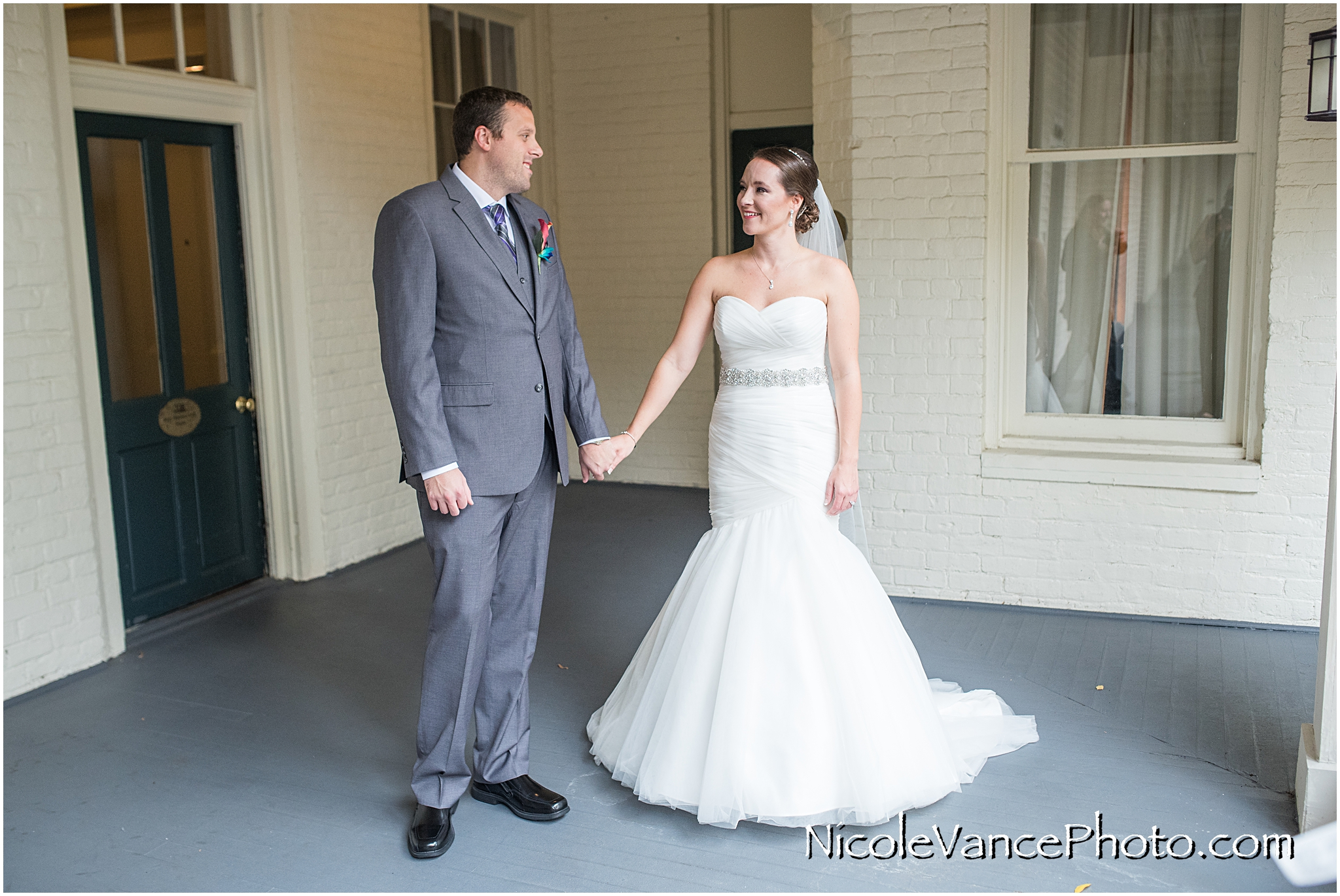 The bride and groom have a private first look on the balcony of the Linden Row Inn.