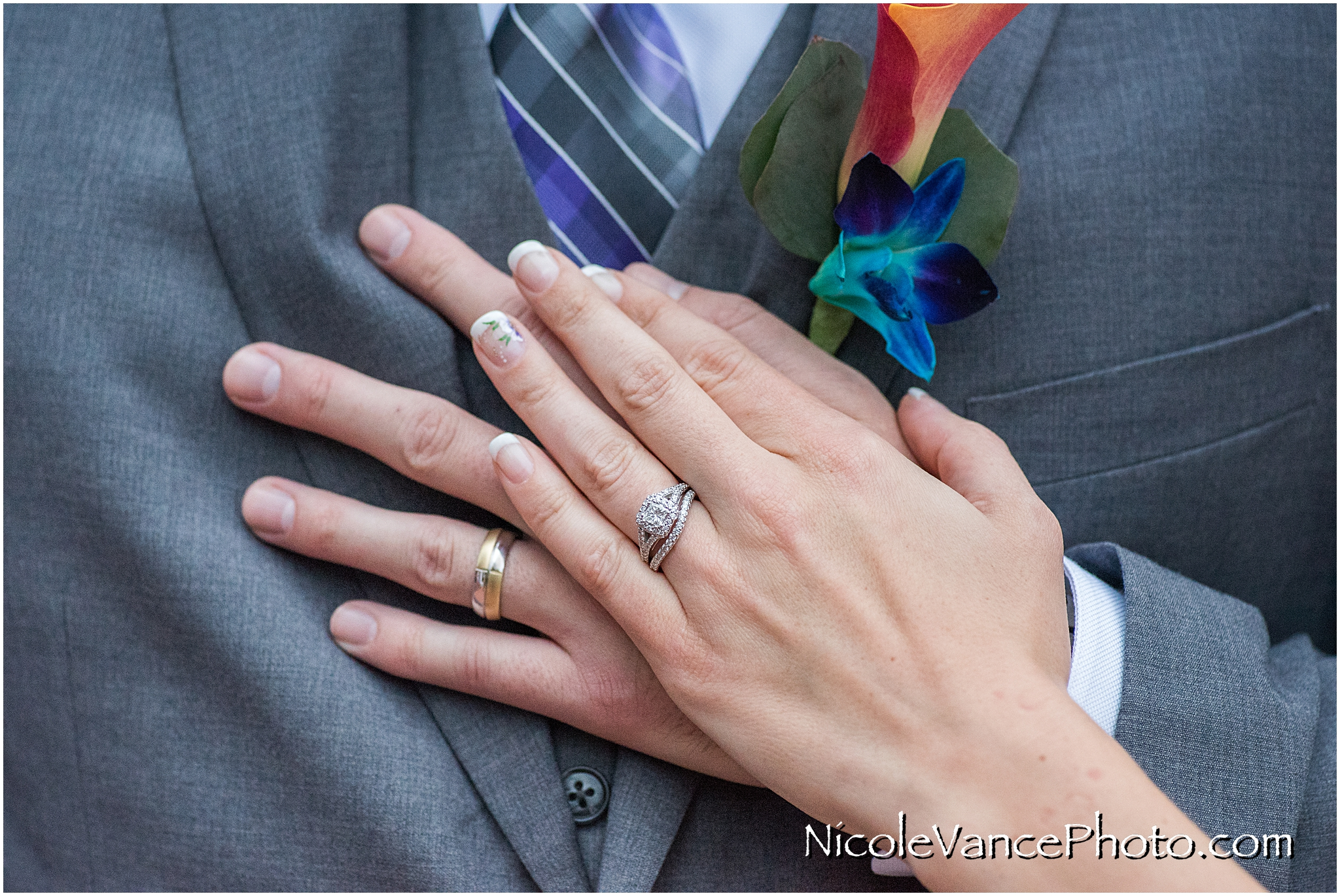 Detailed ring shot with the bride and grooms hands.