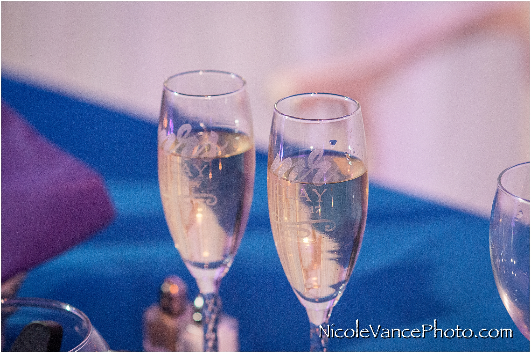 Etched champagne glasses await toasts at the wedding reception at The Brownstone.