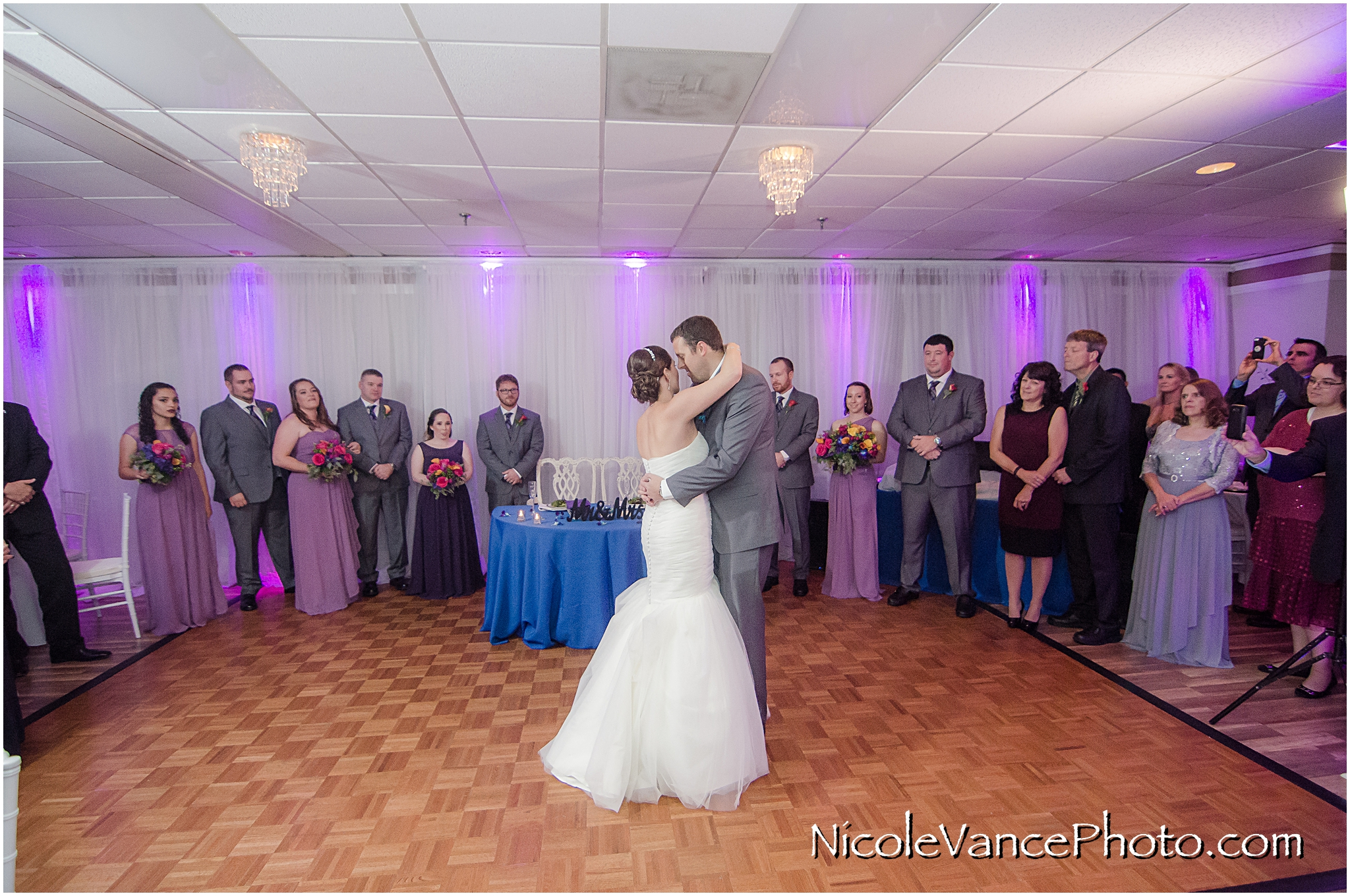 The bride and groom enjoy their first dance at their wedding reception at The Brownstone.
