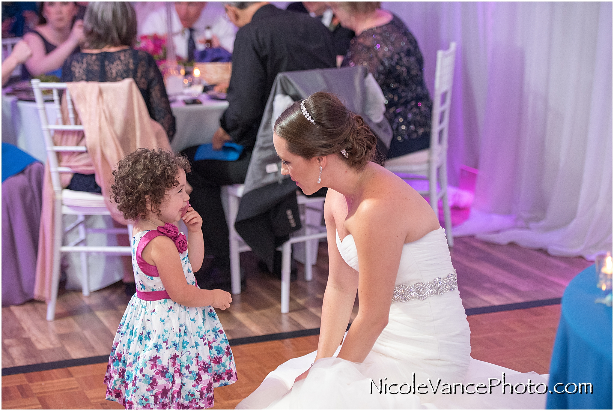 This is a cute moment between the bride and one of her youngest guests.