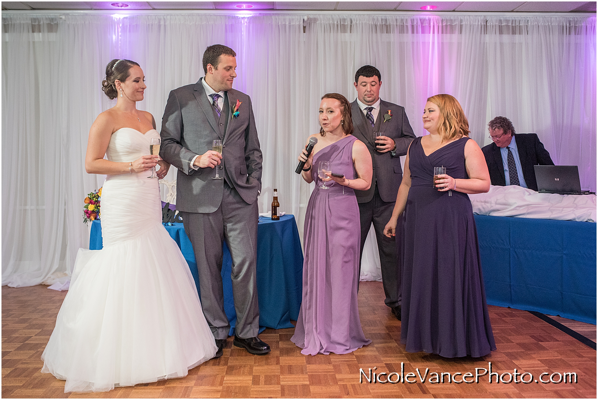 The maid of honor makes a toast to the bride and groom at The Brownstone in Richmond, VA.