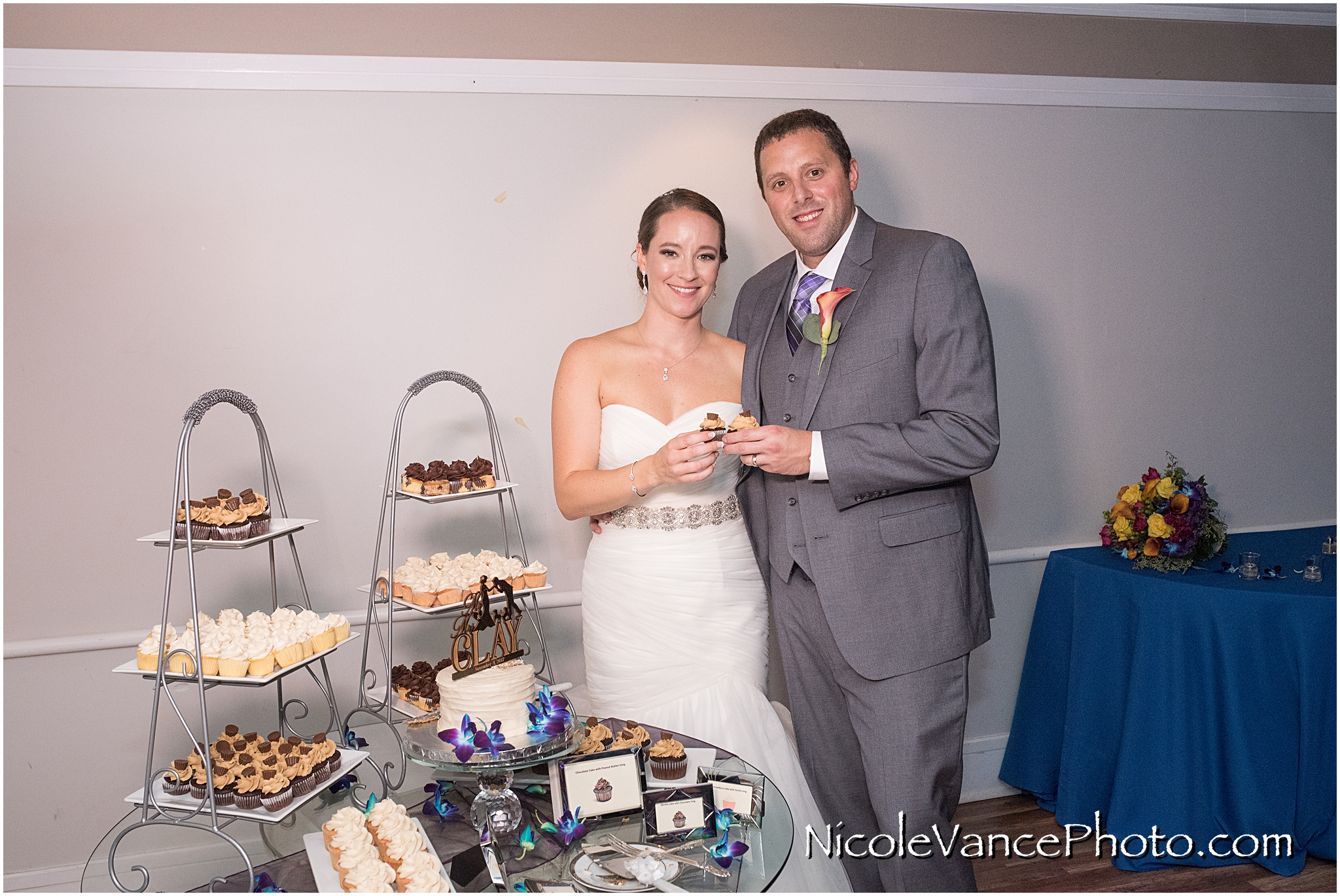 The bride and groom enjoy their cake, provided by Kakealicious at the reception at The Brownstone.