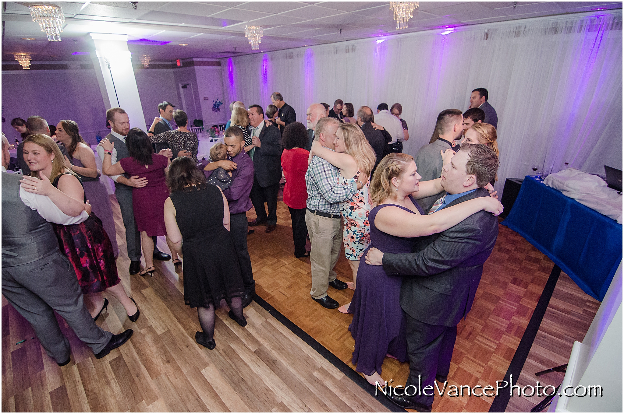 The guests enjoy music provided by DJ Patrick of Nard's DJ services.