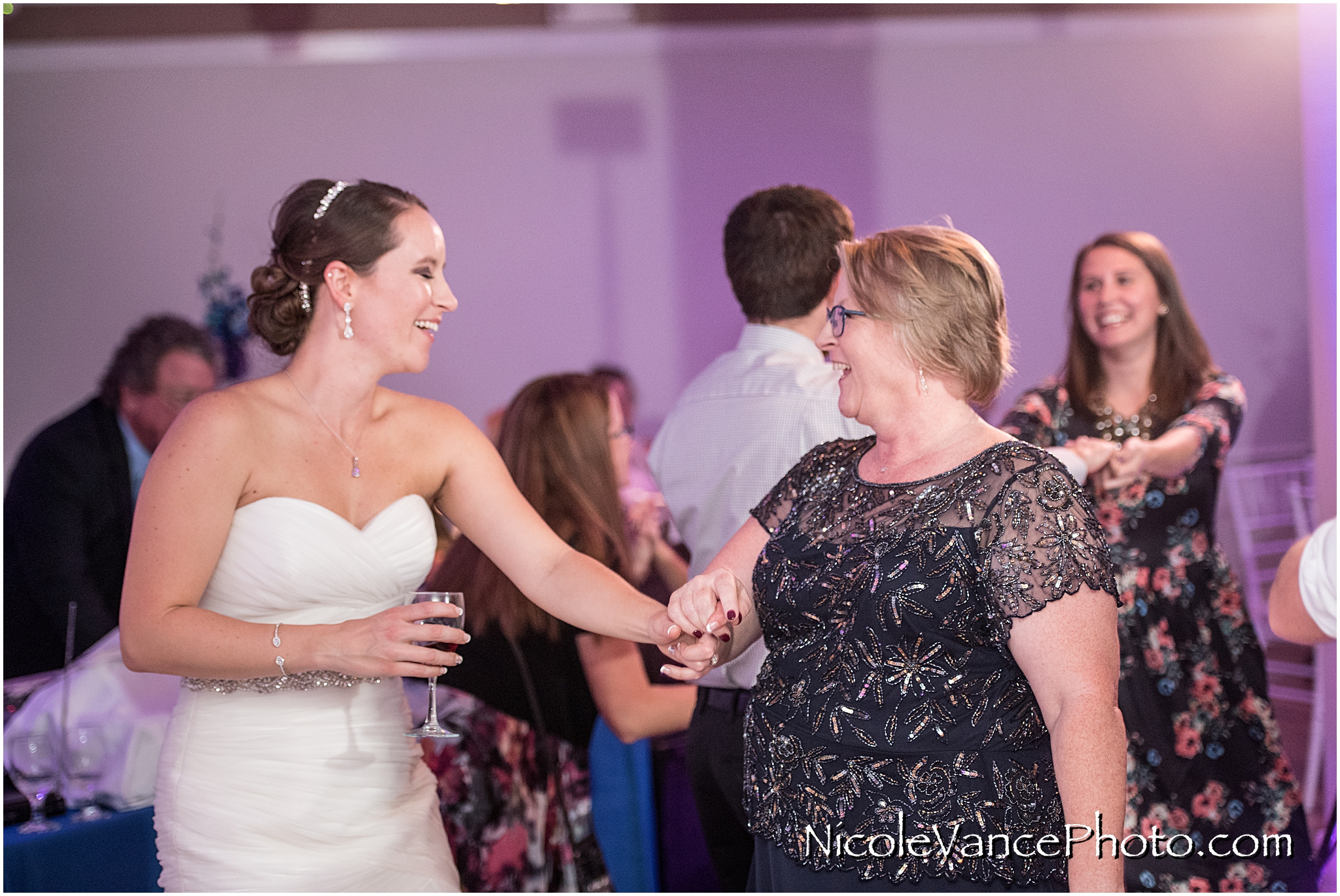 The bride and her mom enjoy the dance floor together.